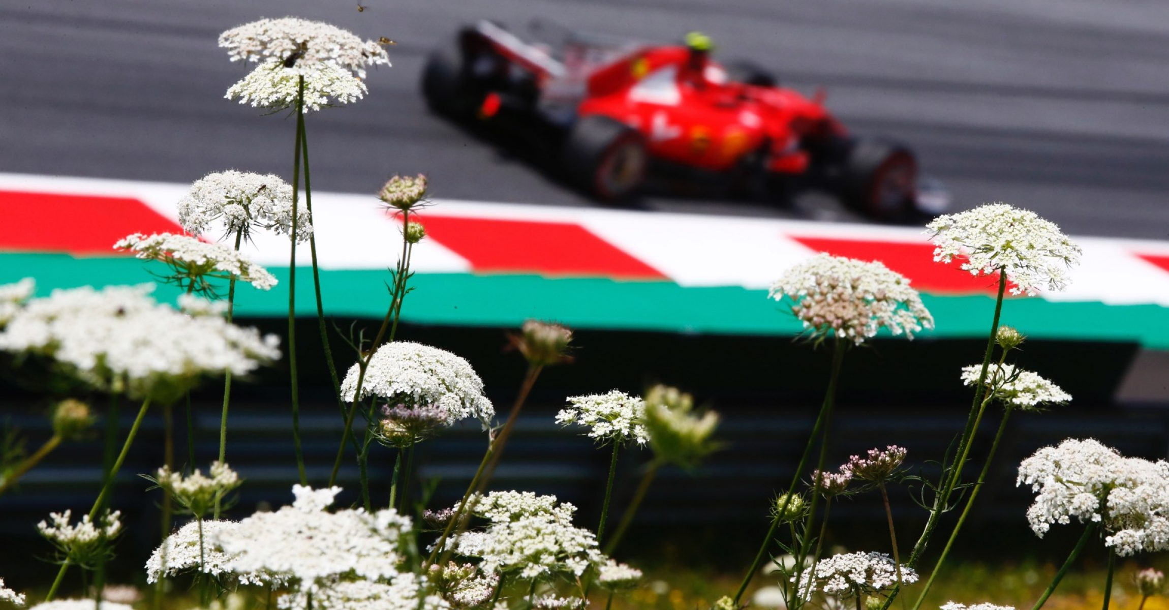 Red Bull Ring, Spielberg, Austria. Friday 07 July 2017. World Copyright: Andy Hone/LAT Images ref: Digital Image _ONY0445, Kimi Räikkönen, Ferrari, flowers,