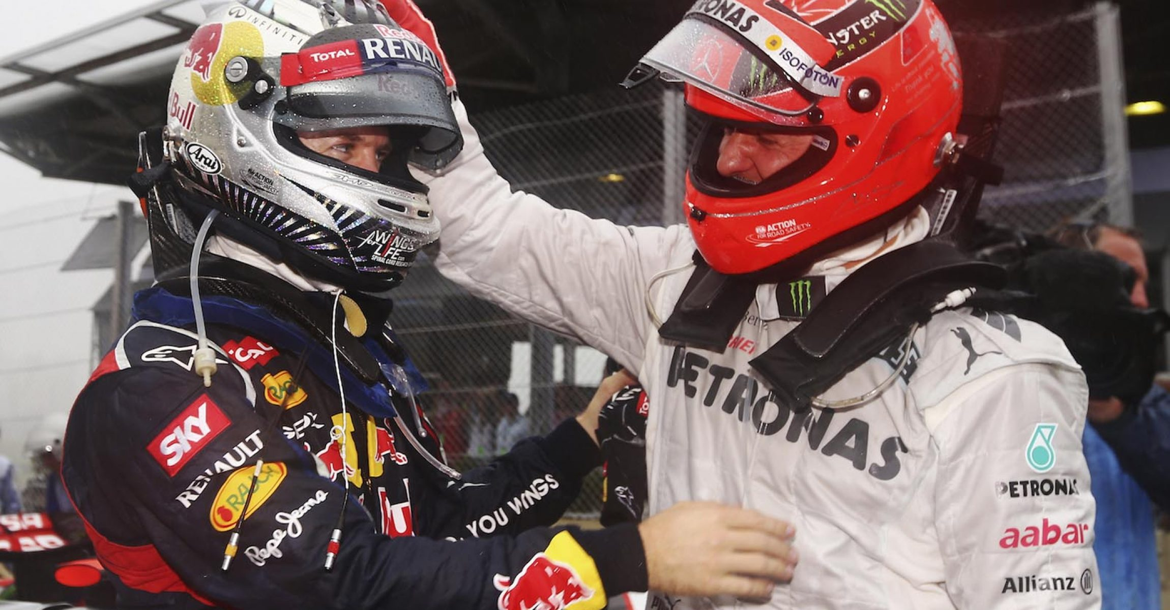 SAO PAULO, BRAZIL - NOVEMBER 25:  Sebastian Vettel of Germany and Red Bull Racing is congratulated by Michael Schumacher of Germany and Mercedes GP in parc ferme as he finishes in sixth position and clinches the drivers world championship during the Brazilian Formula One Grand Prix at the Autodromo Jose Carlos Pace on November 25, 2012 in Sao Paulo, Brazil.  (Photo by Paul Gilham/Getty Images)