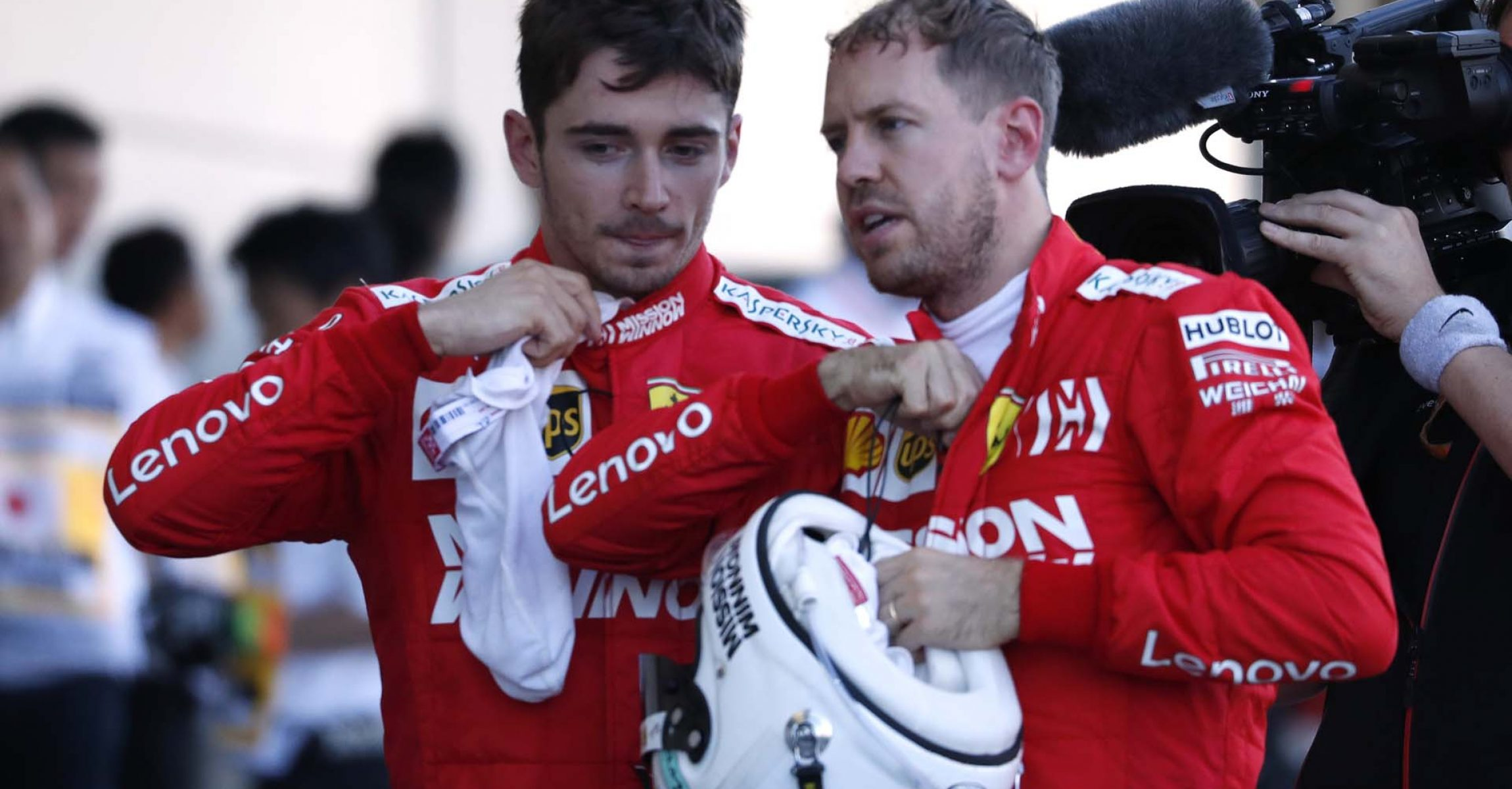 Formula One F1 - Japanese Grand Prix - Suzuka Circuit, Suzuka, Japan - October 13, 2019. Ferrari's Charles Leclerc and Sebastian Vettel after the race. REUTERS/Issei Kato