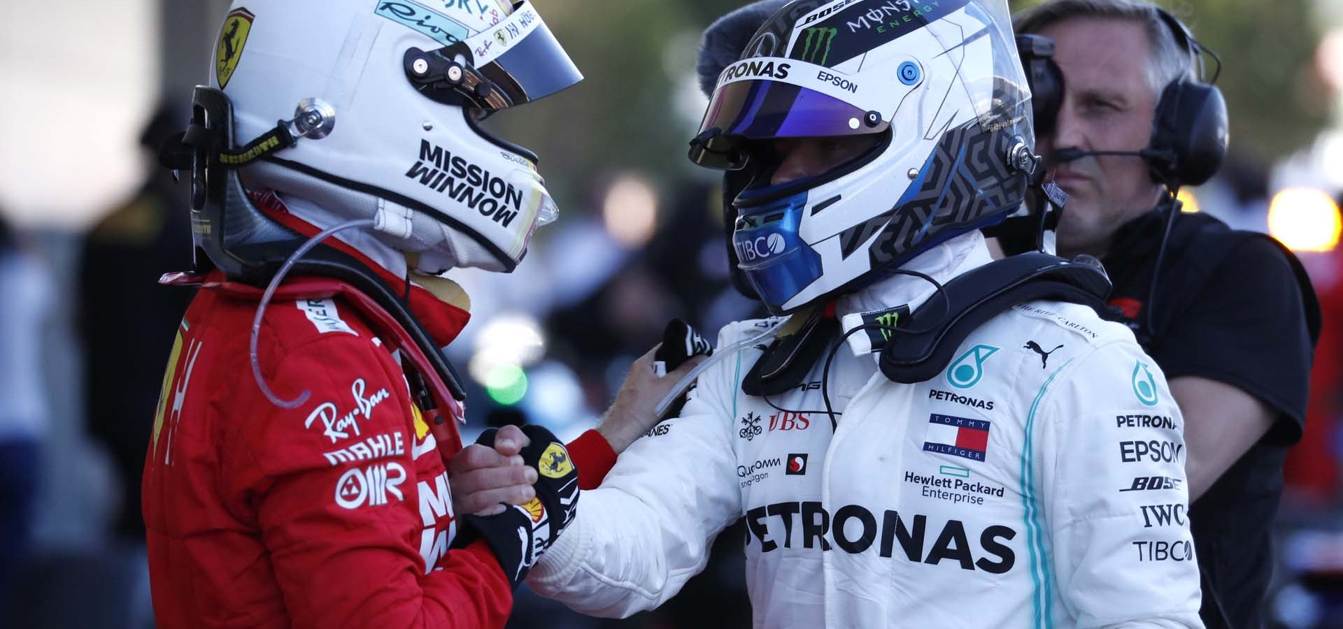 Formula One F1 - Japanese Grand Prix - Suzuka Circuit, Suzuka, Japan - October 13, 2019. Mercedes' Valtteri Bottas shakes hands with Ferrari's Sebastian Vettel after winning the race. REUTERS/Issei Kato