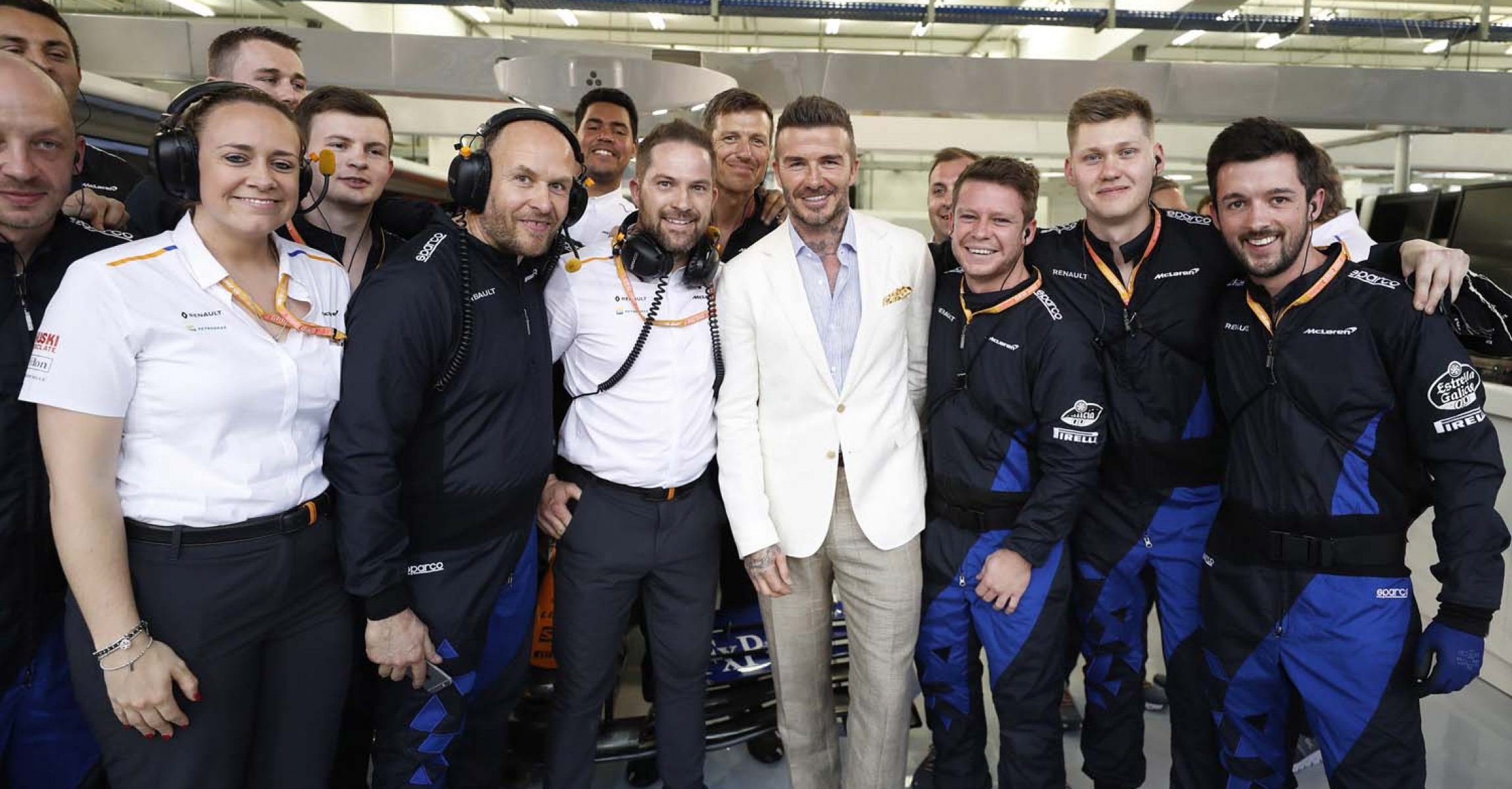 Footballer David Beckham meets the team in the garage