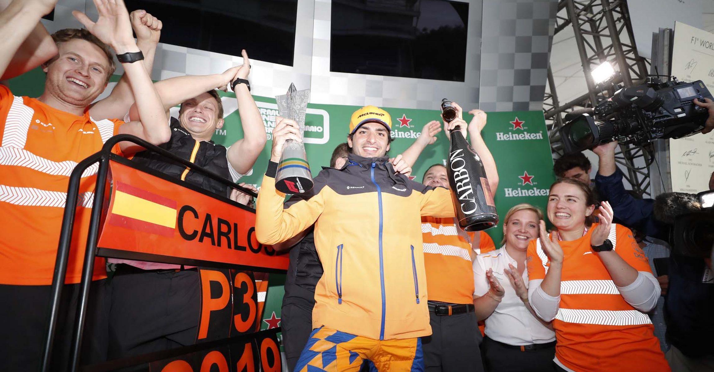 Carlos Sainz, McLaren, celebrates on the podium
