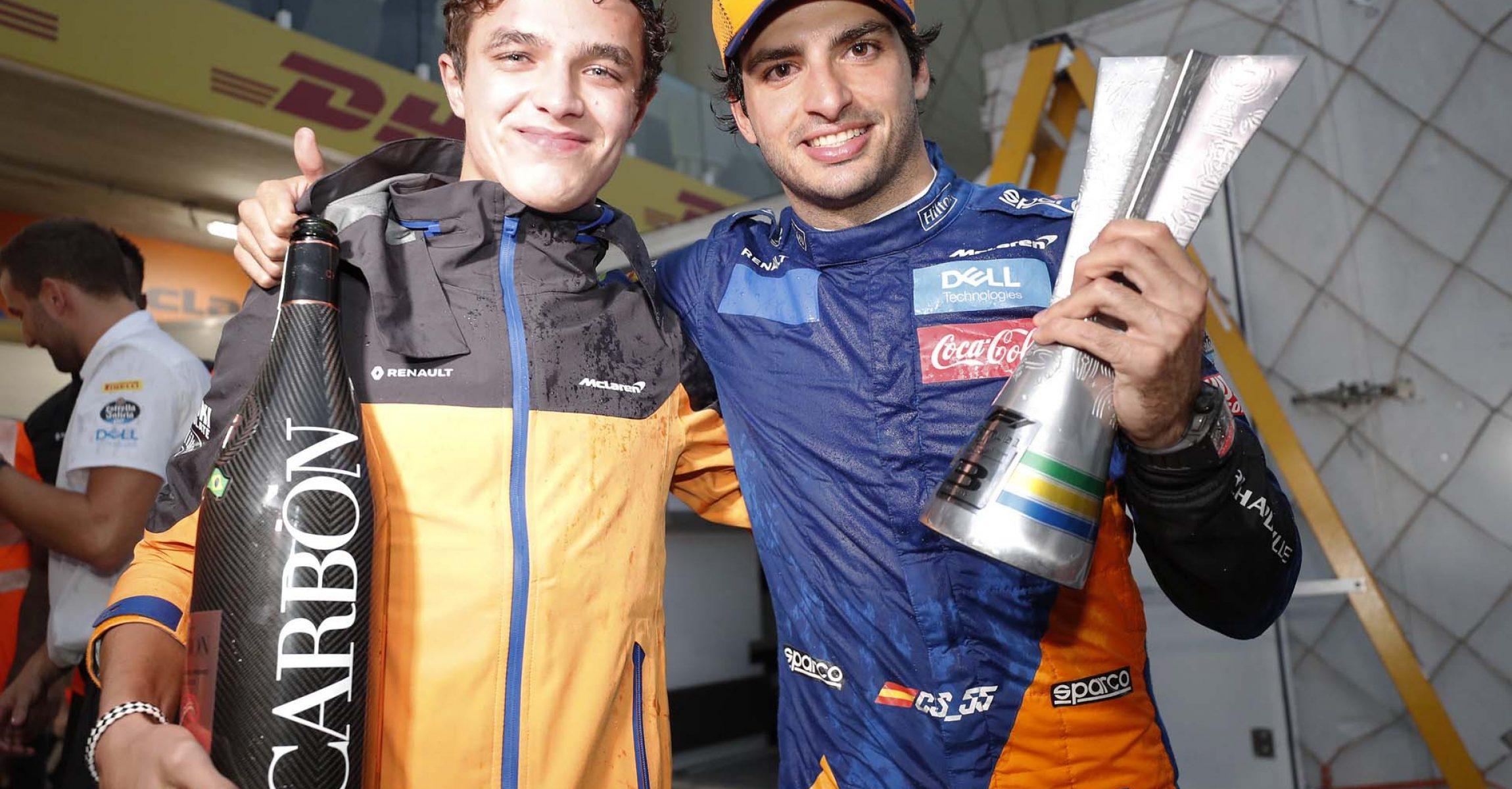 Carlos Sainz, McLaren, celebrates with Lando Norris, McLaren