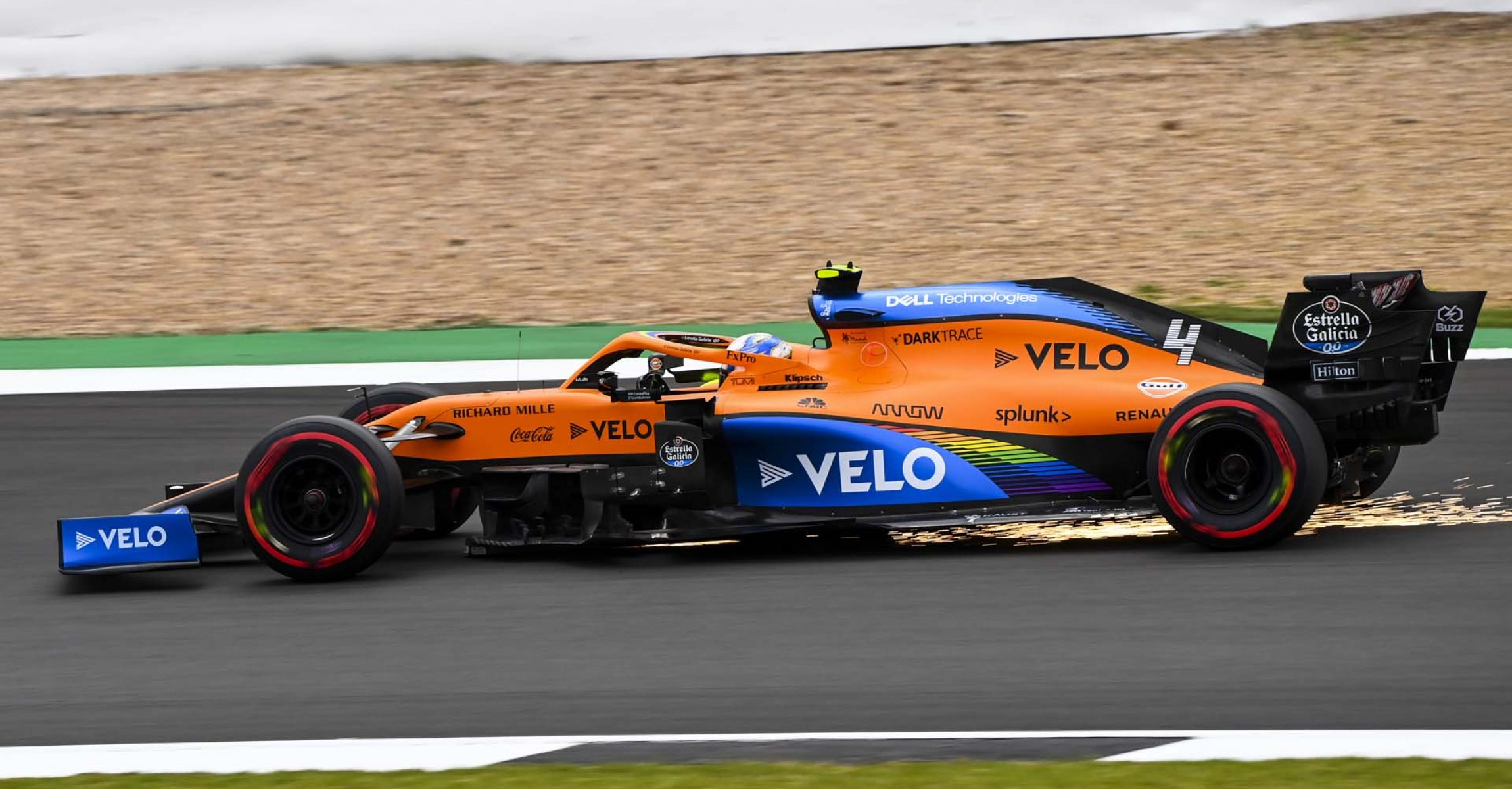Sparks under the car of Lando Norris, McLaren MCL35