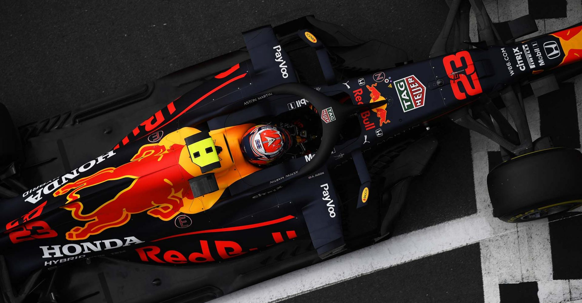 NORTHAMPTON, ENGLAND - AUGUST 08: Alexander Albon of Thailand driving the (23) Aston Martin Red Bull Racing RB16 driving in the pit lane during qualifying for the F1 70th Anniversary Grand Prix at Silverstone on August 08, 2020 in Northampton, England. (Photo by Rudy Carezzevoli/Getty Images)