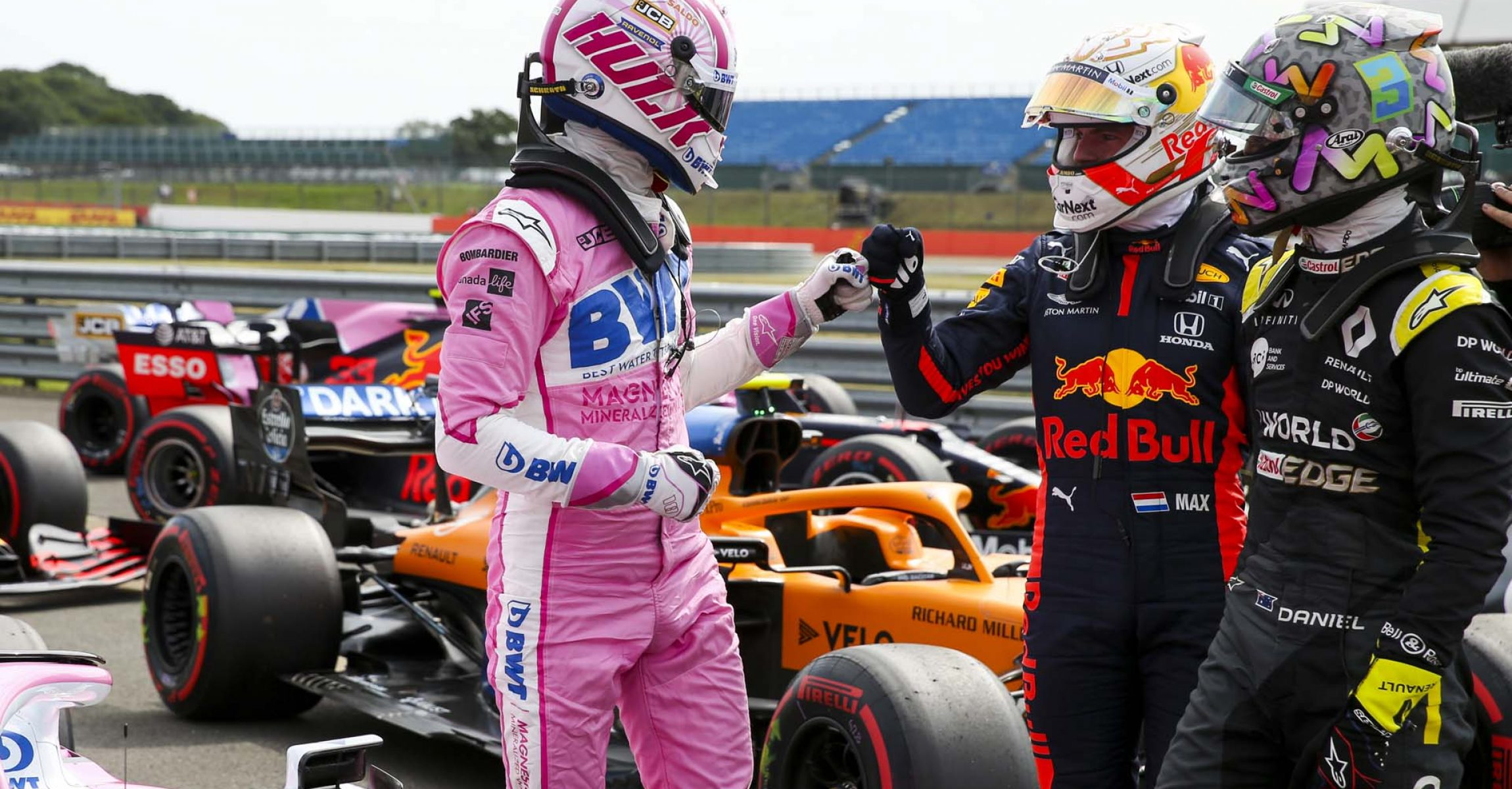 Daniel Ricciardo, Renault F1, and Max Verstappen, Red Bull Racing, congratulate Nico Hülkenberg, Racing Point RP20, in Parc Ferme after he secured third on the grid