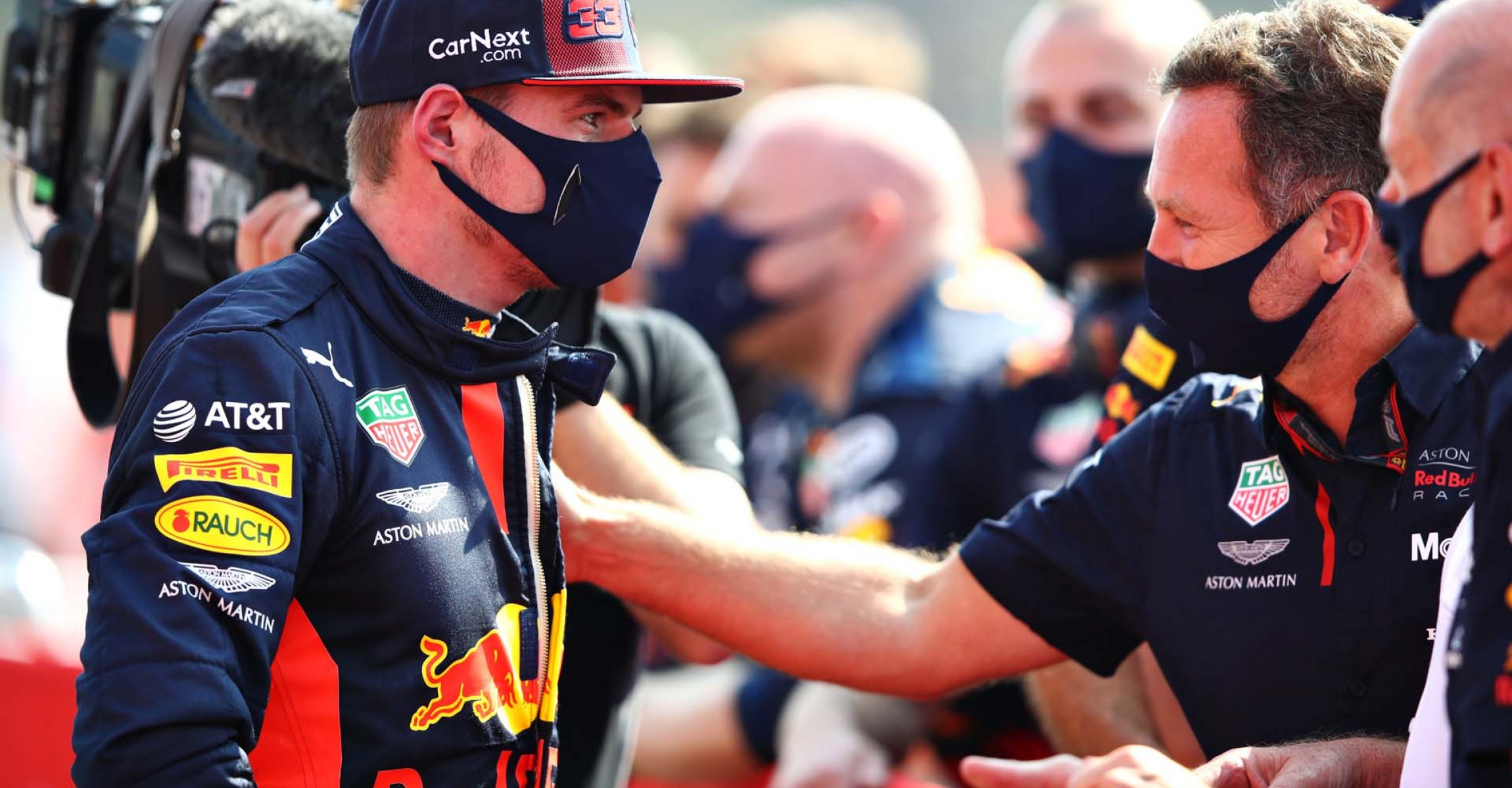 NORTHAMPTON, ENGLAND - AUGUST 09: Race winner Max Verstappen of Netherlands and Red Bull Racing celebrates with Red Bull Racing Team Principal Christian Horner in parc ferme during the F1 70th Anniversary Grand Prix at Silverstone on August 09, 2020 in Northampton, England. (Photo by Mark Thompson/Getty Images)