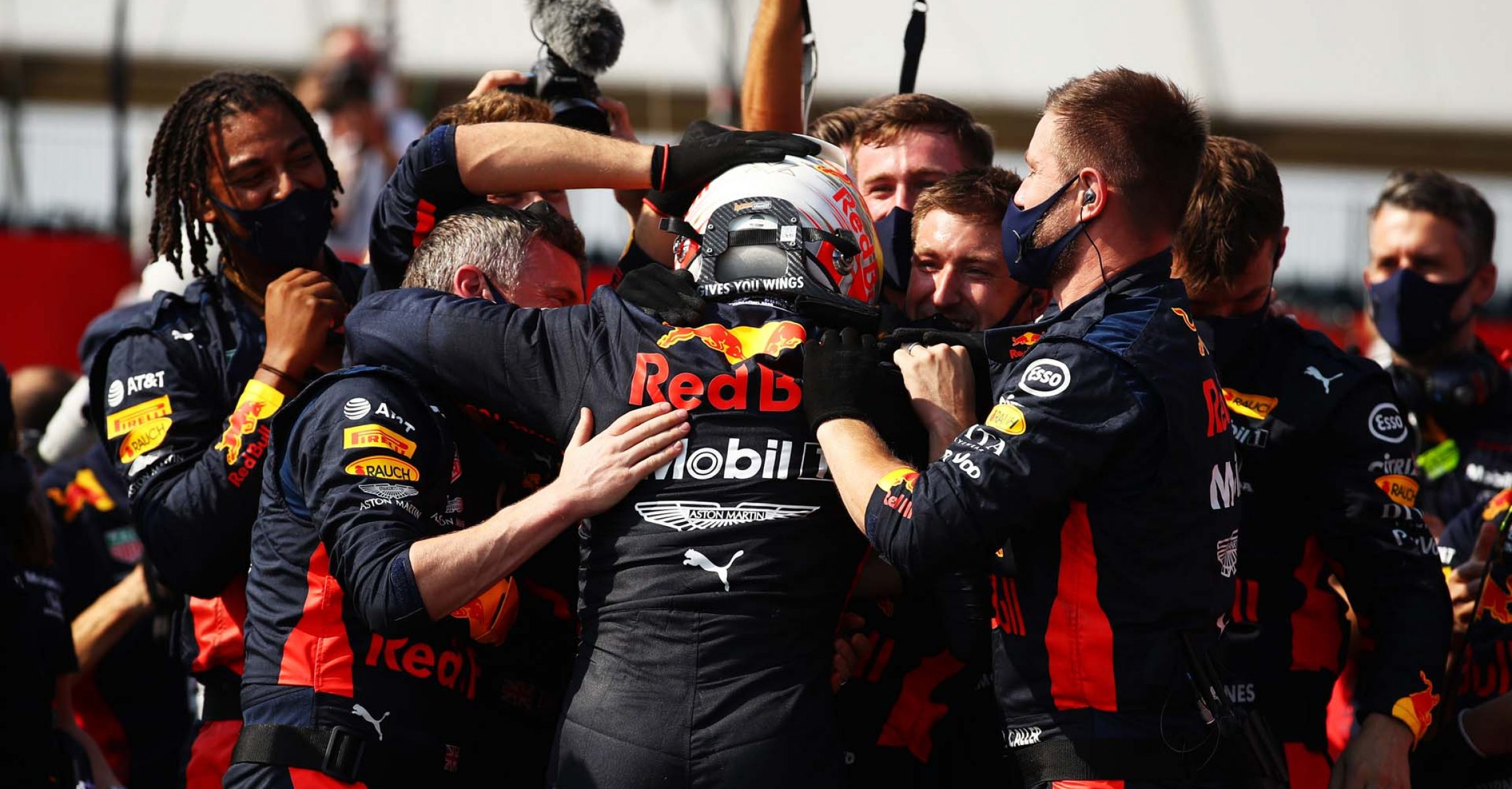 NORTHAMPTON, ENGLAND - AUGUST 09: Race winner Max Verstappen of Netherlands and Red Bull Racing celebrates with teammates in parc ferme during the F1 70th Anniversary Grand Prix at Silverstone on August 09, 2020 in Northampton, England. (Photo by Bryn Lennon/Getty Images)