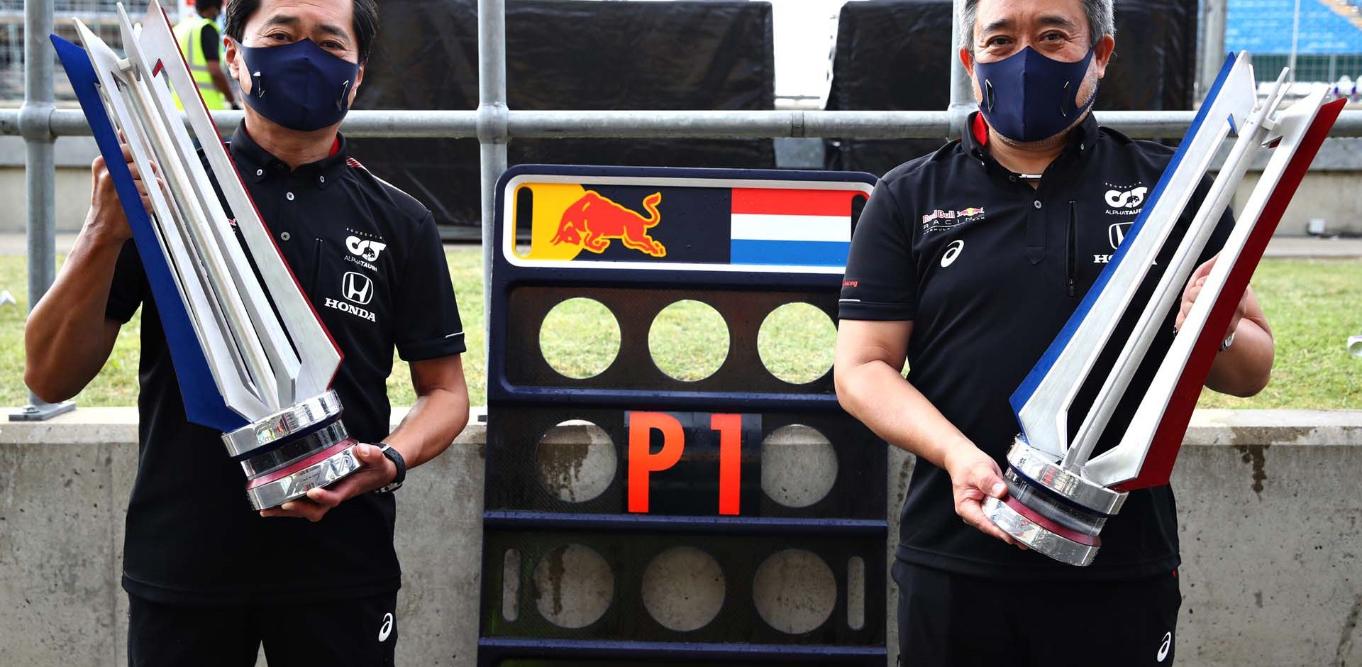NORTHAMPTON, ENGLAND - AUGUST 09: Toyoharu Tanabe of Honda and Masashi Yamamoto of Honda celebrate the win of Max Verstappen of Netherlands and Red Bull Racing after the F1 70th Anniversary Grand Prix at Silverstone on August 09, 2020 in Northampton, England. (Photo by Mark Thompson/Getty Images) // Getty Images / Red Bull Content Pool  // AP-24VZHS93H1W11 // Usage for editorial use only //