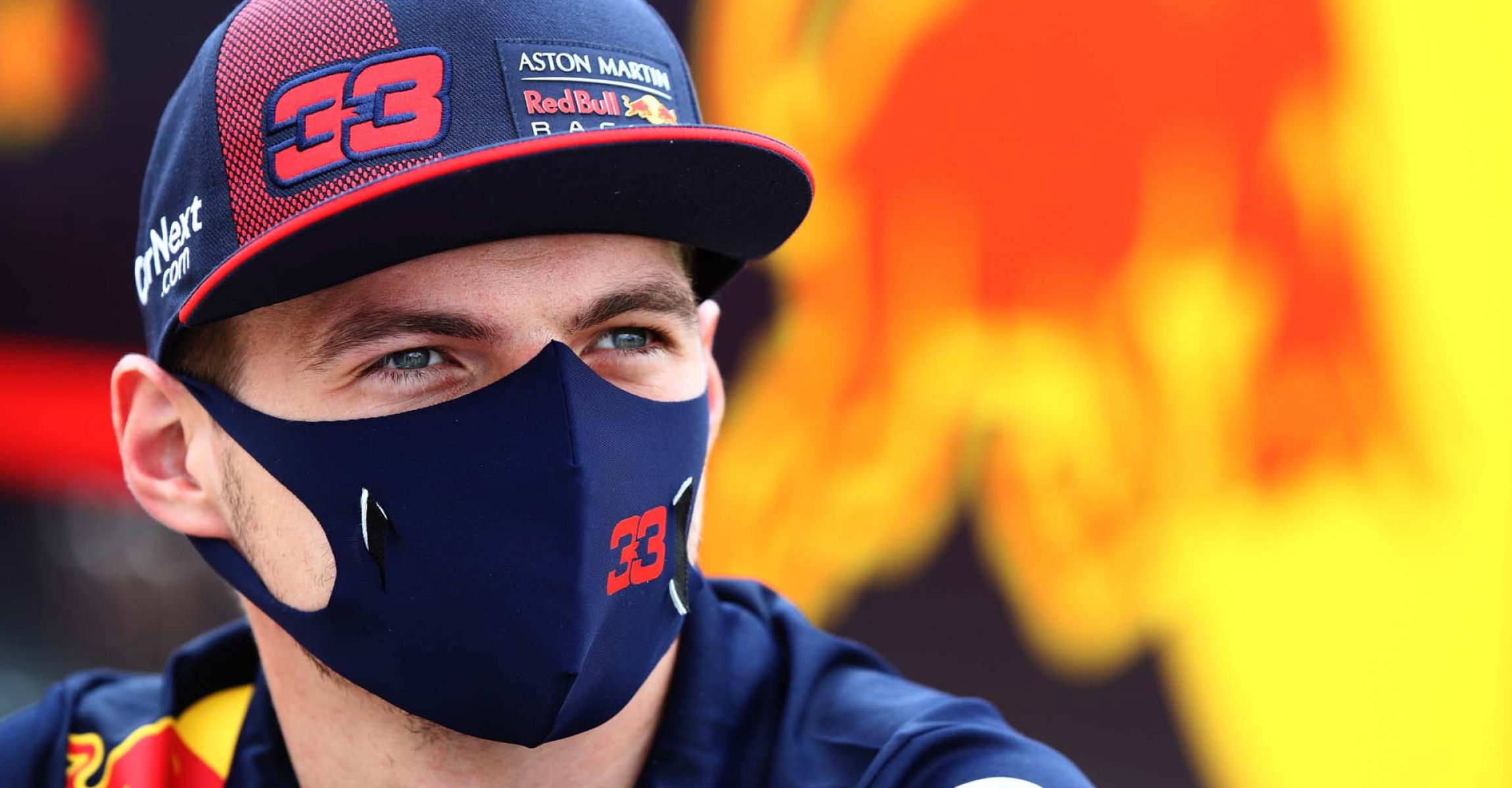 NORTHAMPTON, ENGLAND - AUGUST 06: Max Verstappen of Netherlands and Red Bull Racing looks on in the Paddock during previews ahead of the F1 70th Anniversary Grand Prix at Silverstone on August 06, 2020 in Northampton, England. (Photo by Mark Thompson/Getty Images)