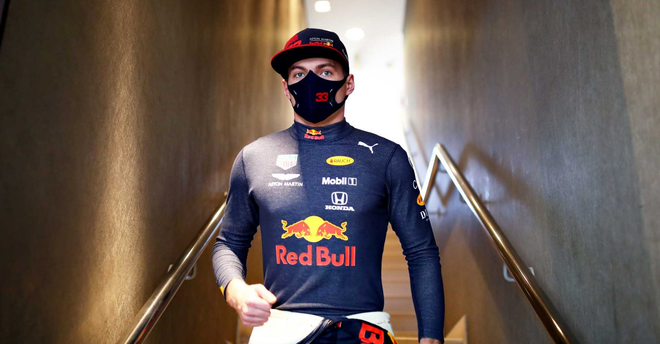 ABU DHABI, UNITED ARAB EMIRATES - DECEMBER 11: Max Verstappen of Netherlands and Red Bull Racing walks to the garage before practice ahead of the F1 Grand Prix of Abu Dhabi at Yas Marina Circuit on December 11, 2020 in Abu Dhabi, United Arab Emirates. (Photo by Mark Thompson/Getty Images)