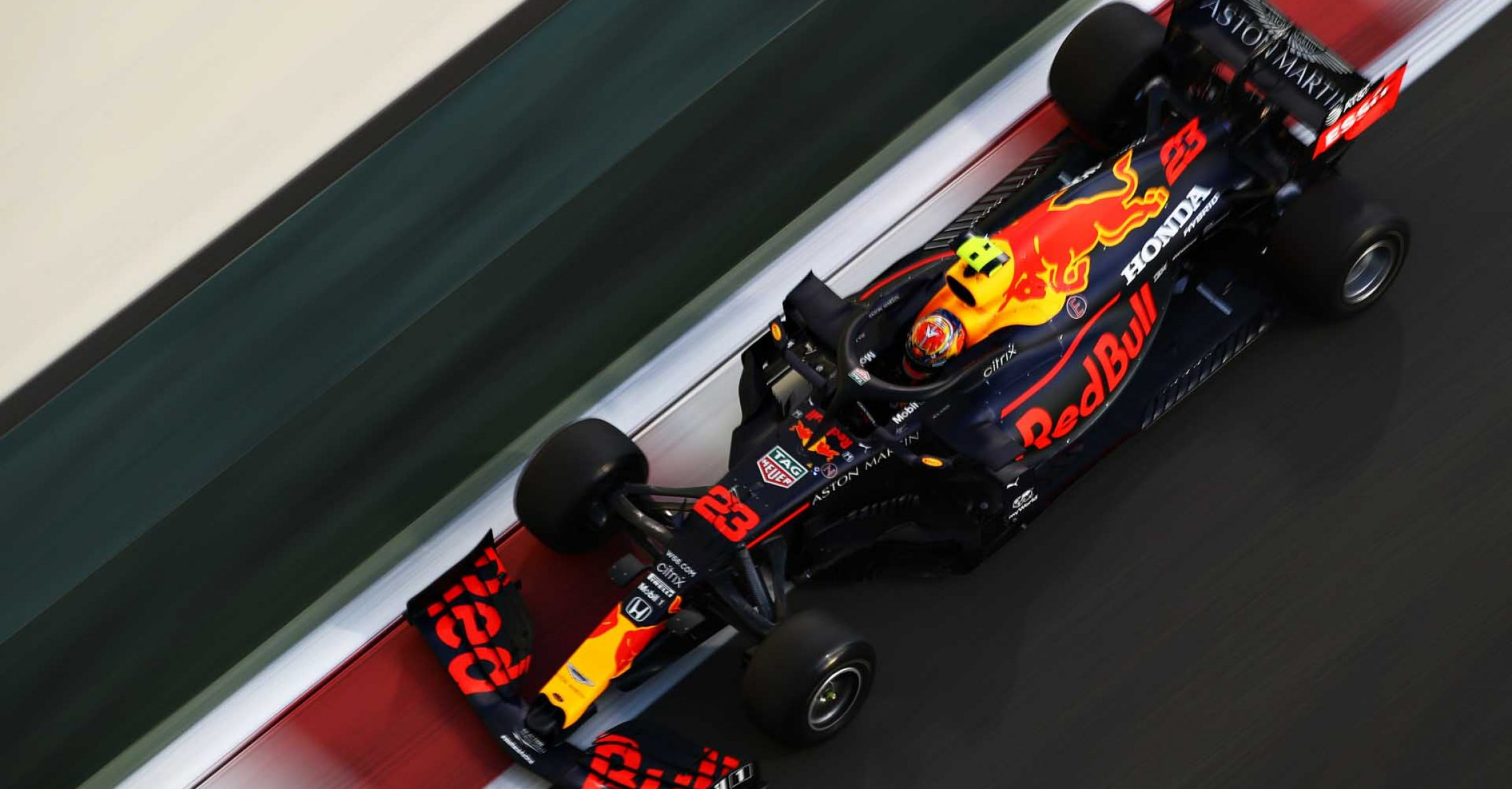 ABU DHABI, UNITED ARAB EMIRATES - DECEMBER 11: Alexander Albon of Thailand driving the (23) Aston Martin Red Bull Racing RB16 during practice ahead of the F1 Grand Prix of Abu Dhabi at Yas Marina Circuit on December 11, 2020 in Abu Dhabi, United Arab Emirates. (Photo by Mark Thompson/Getty Images)