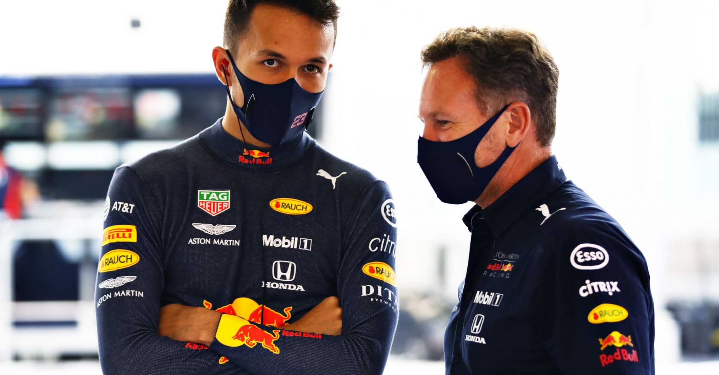 ABU DHABI, UNITED ARAB EMIRATES - DECEMBER 12: Alexander Albon of Thailand and Red Bull Racing and Red Bull Racing Team Principal Christian Horner talk in the garage prior to qualifying ahead of the F1 Grand Prix of Abu Dhabi at Yas Marina Circuit on December 12, 2020 in Abu Dhabi, United Arab Emirates. (Photo by Mark Thompson/Getty Images)