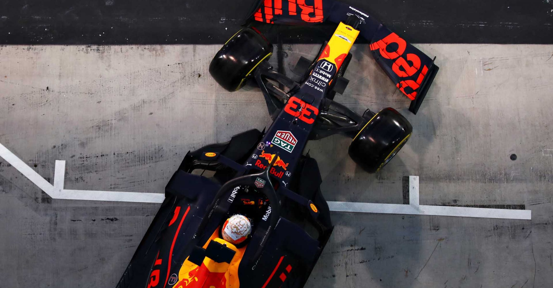 ABU DHABI, UNITED ARAB EMIRATES - DECEMBER 12: Max Verstappen of the Netherlands driving the (33) Aston Martin Red Bull Racing RB16 leaves the garage during qualifying ahead of the F1 Grand Prix of Abu Dhabi at Yas Marina Circuit on December 12, 2020 in Abu Dhabi, United Arab Emirates. (Photo by Mark Thompson/Getty Images)