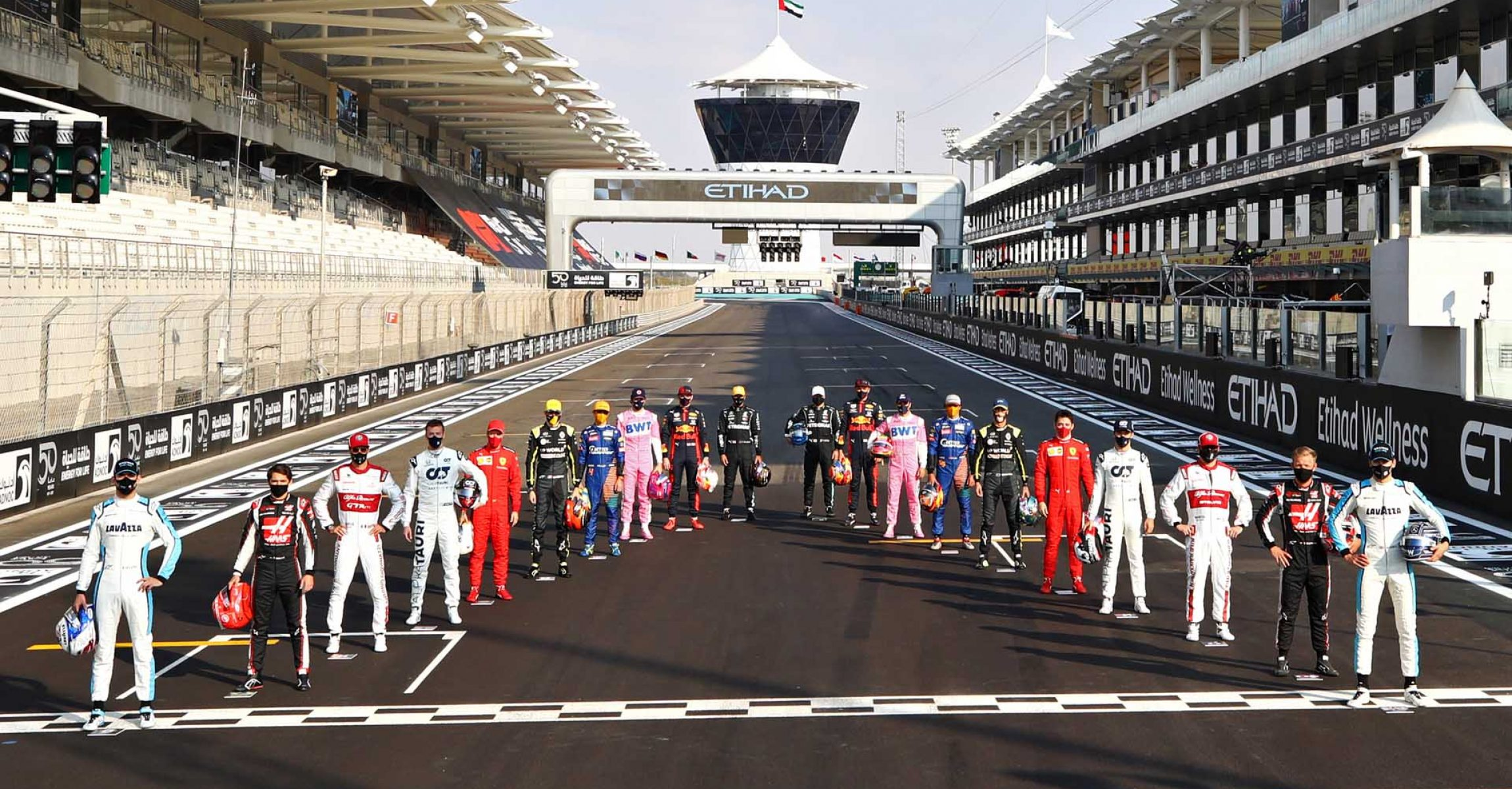 ABU DHABI, UNITED ARAB EMIRATES - DECEMBER 13: The F1 drivers pose for the Class of 2020 photo on the grid prior to the F1 Grand Prix of Abu Dhabi at Yas Marina Circuit on December 13, 2020 in Abu Dhabi, United Arab Emirates. Red Bull Racing (Photo by Bryn Lennon/Getty Images)