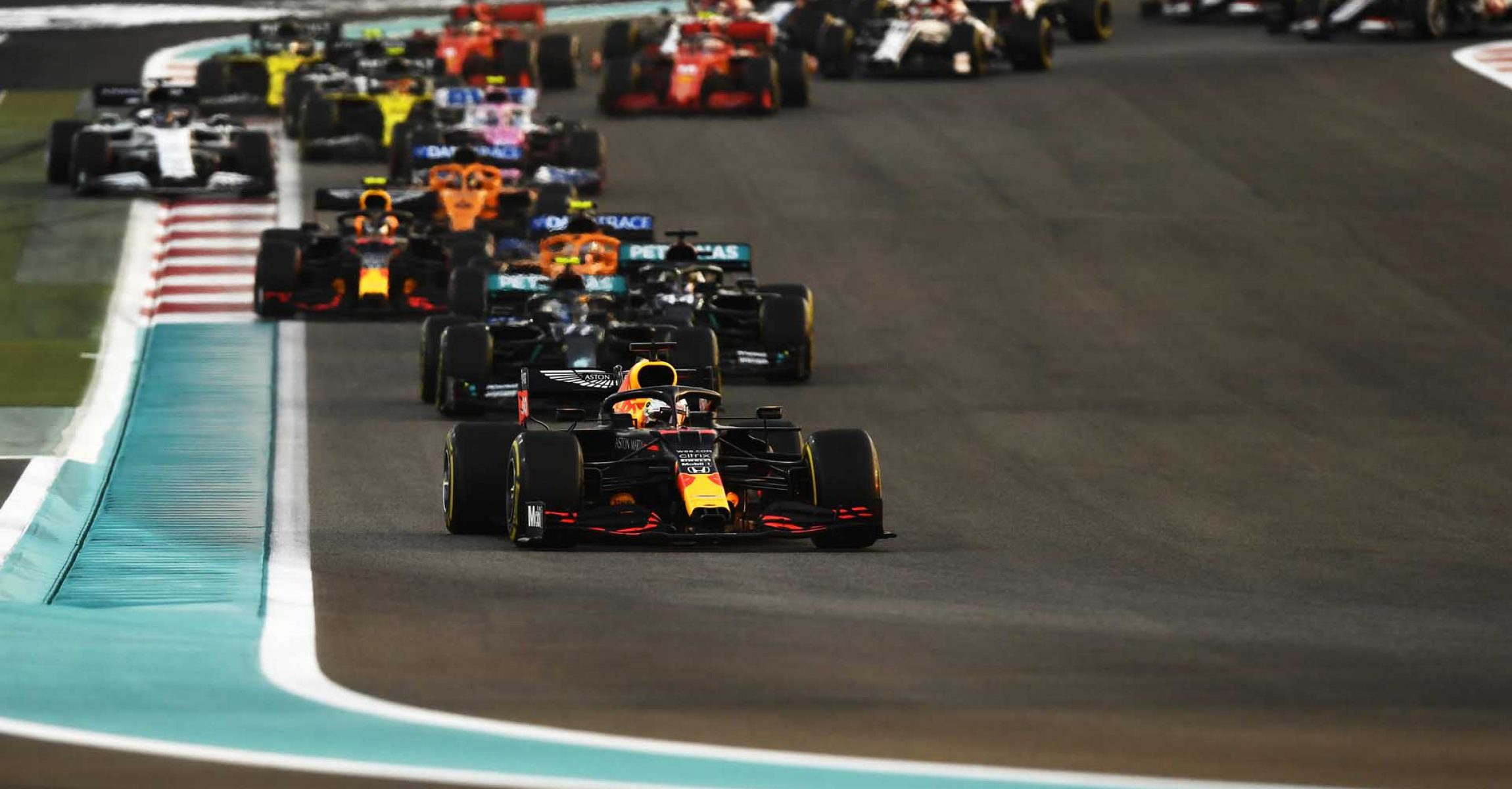ABU DHABI, UNITED ARAB EMIRATES - DECEMBER 13: Max Verstappen of the Netherlands driving the (33) Aston Martin Red Bull Racing RB16 leads the field at the start during the F1 Grand Prix of Abu Dhabi at Yas Marina Circuit on December 13, 2020 in Abu Dhabi, United Arab Emirates. (Photo by Rudy Carezzevoli/Getty Images)