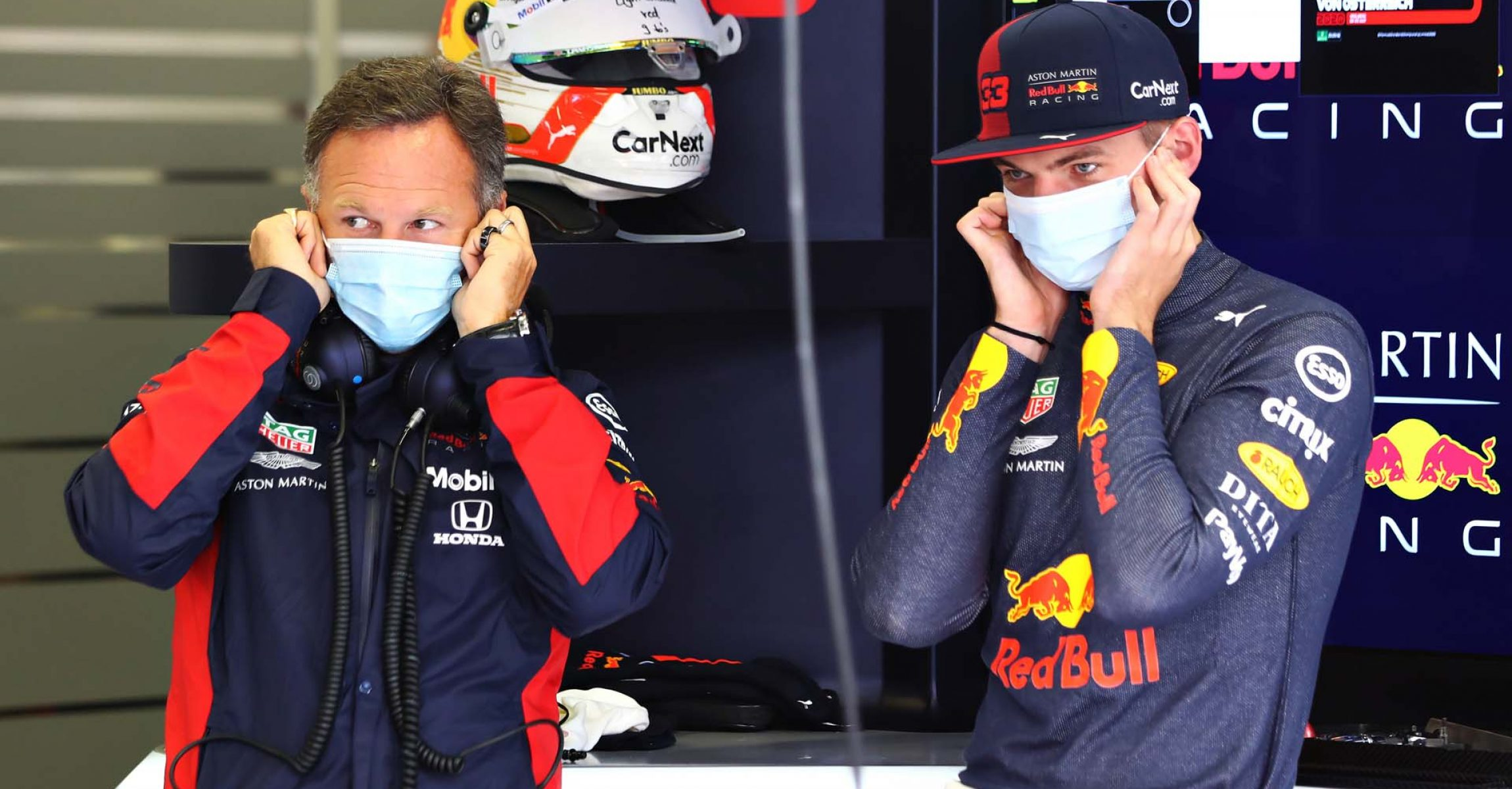 SPIELBERG, AUSTRIA - JULY 03: Max Verstappen of Netherlands and Red Bull Racing and Red Bull Racing Team Principal Christian Horner look on in the garage during practice for the F1 Grand Prix of Austria at Red Bull Ring on July 03, 2020 in Spielberg, Austria. (Photo by Getty Images/Getty Images) // Getty Images / Red Bull Content Pool // AP-24GYZV1812111 // Usage for editorial use only //