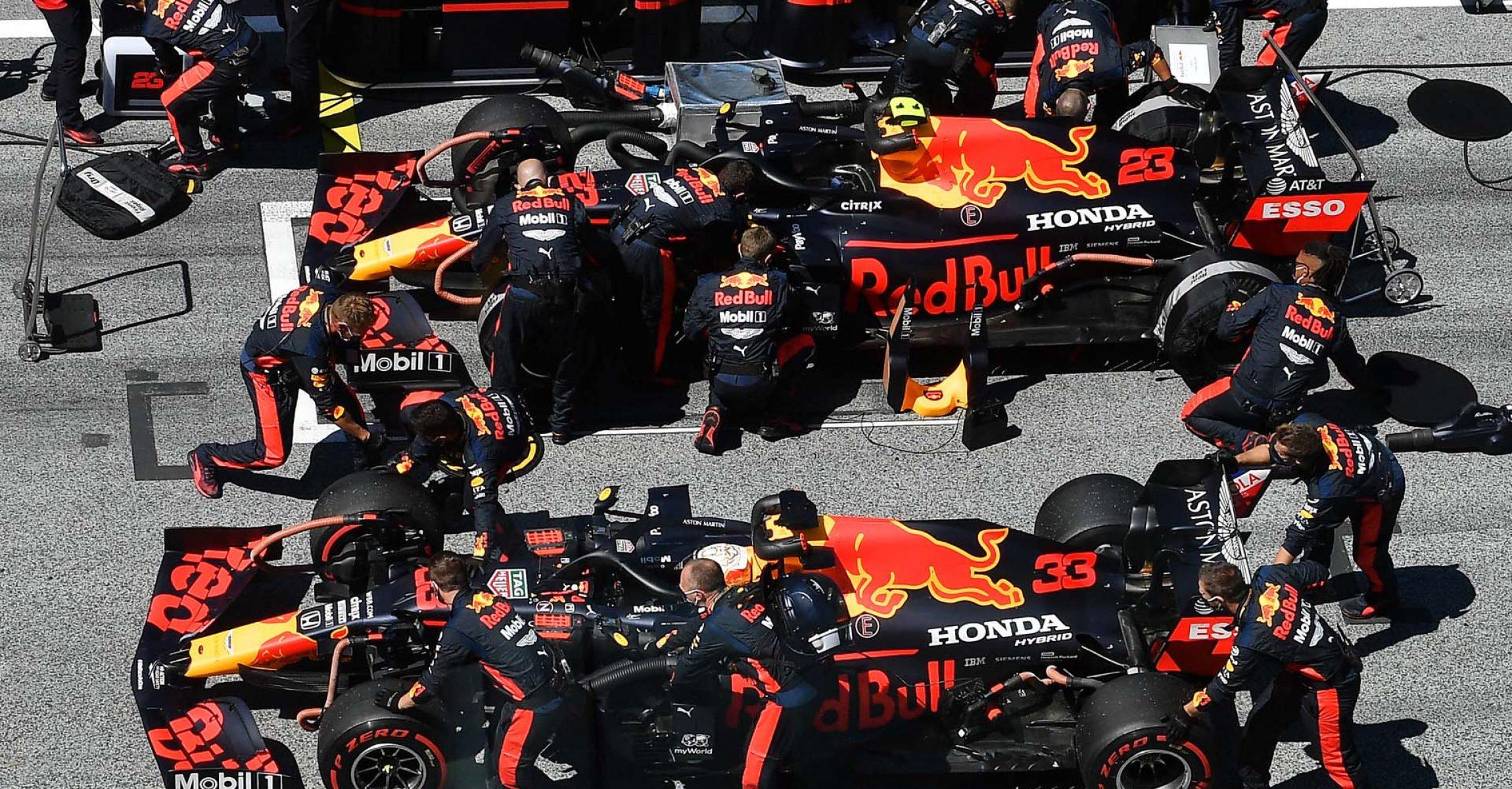 SPIELBERG, AUSTRIA - JULY 05: The cars of Max Verstappen of Netherlands and Red Bull Racing and Alexander Albon of Thailand and Red Bull Racing are prepared on the grid ahead of the Formula One Grand Prix of Austria at Red Bull Ring on July 05, 2020 in Spielberg, Austria. (Photo by Joe Klamar/Pool via Getty Images)