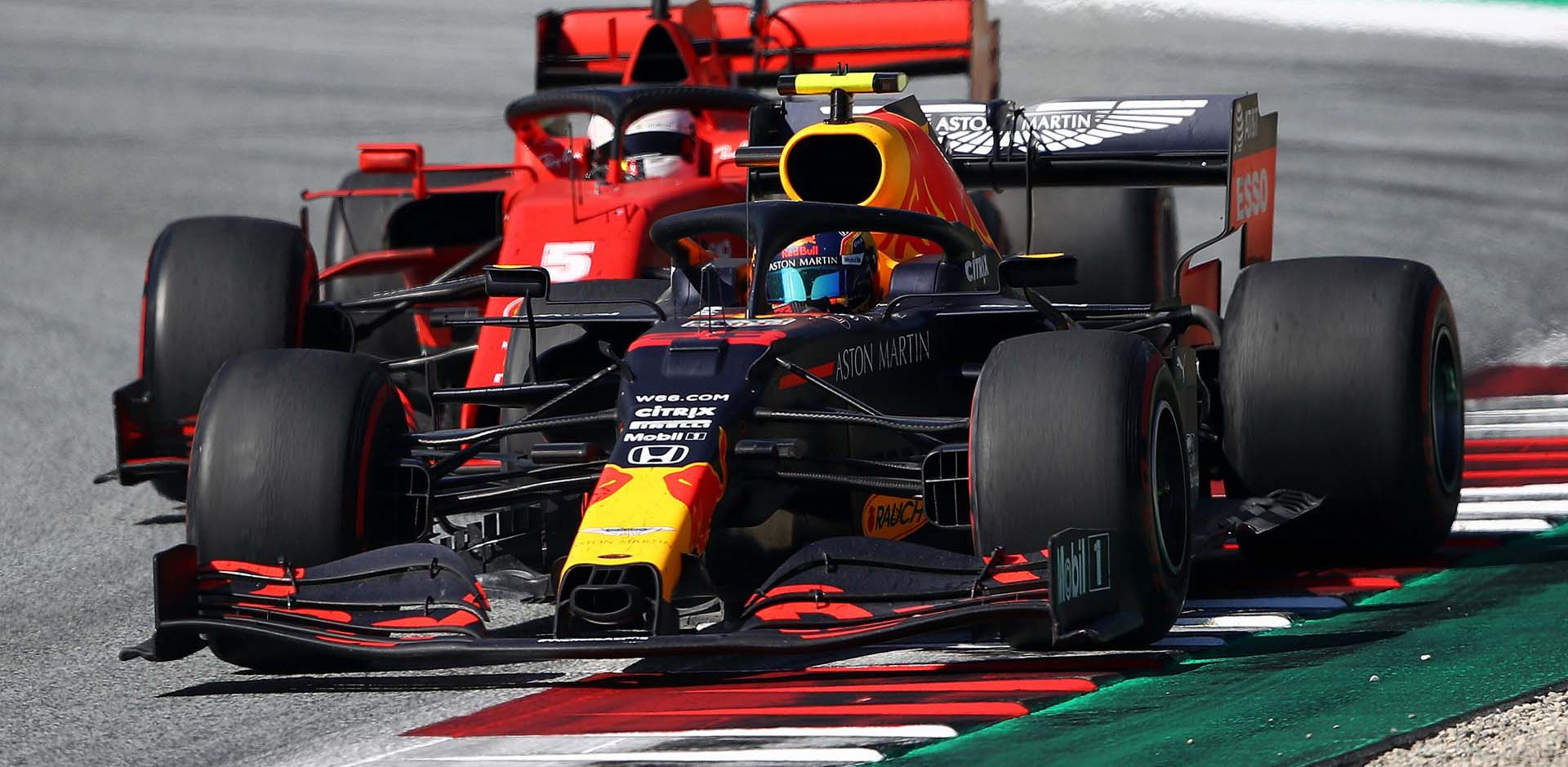 SPIELBERG, AUSTRIA - JULY 05: Alexander Albon of Thailand driving the (23) Aston Martin Red Bull Racing RB16 leads Sebastian Vettel of Germany driving the (5) Scuderia Ferrari SF1000 during the Formula One Grand Prix of Austria at Red Bull Ring on July 05, 2020 in Spielberg, Austria. (Photo by Bryn Lennon/Getty Images) // Getty Images / Red Bull Content Pool  // AP-24HQA38ZS1W11 // Usage for editorial use only //