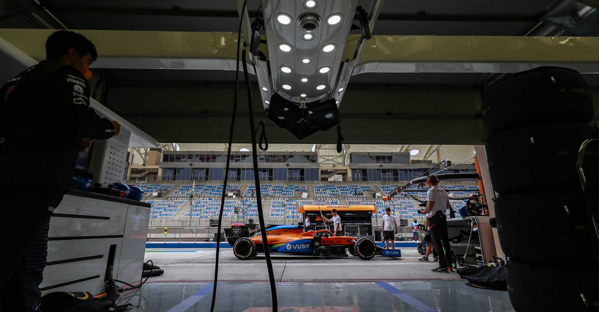 Carlos Sainz, McLaren MCL35, stops outside of this pit garage in the pit lane