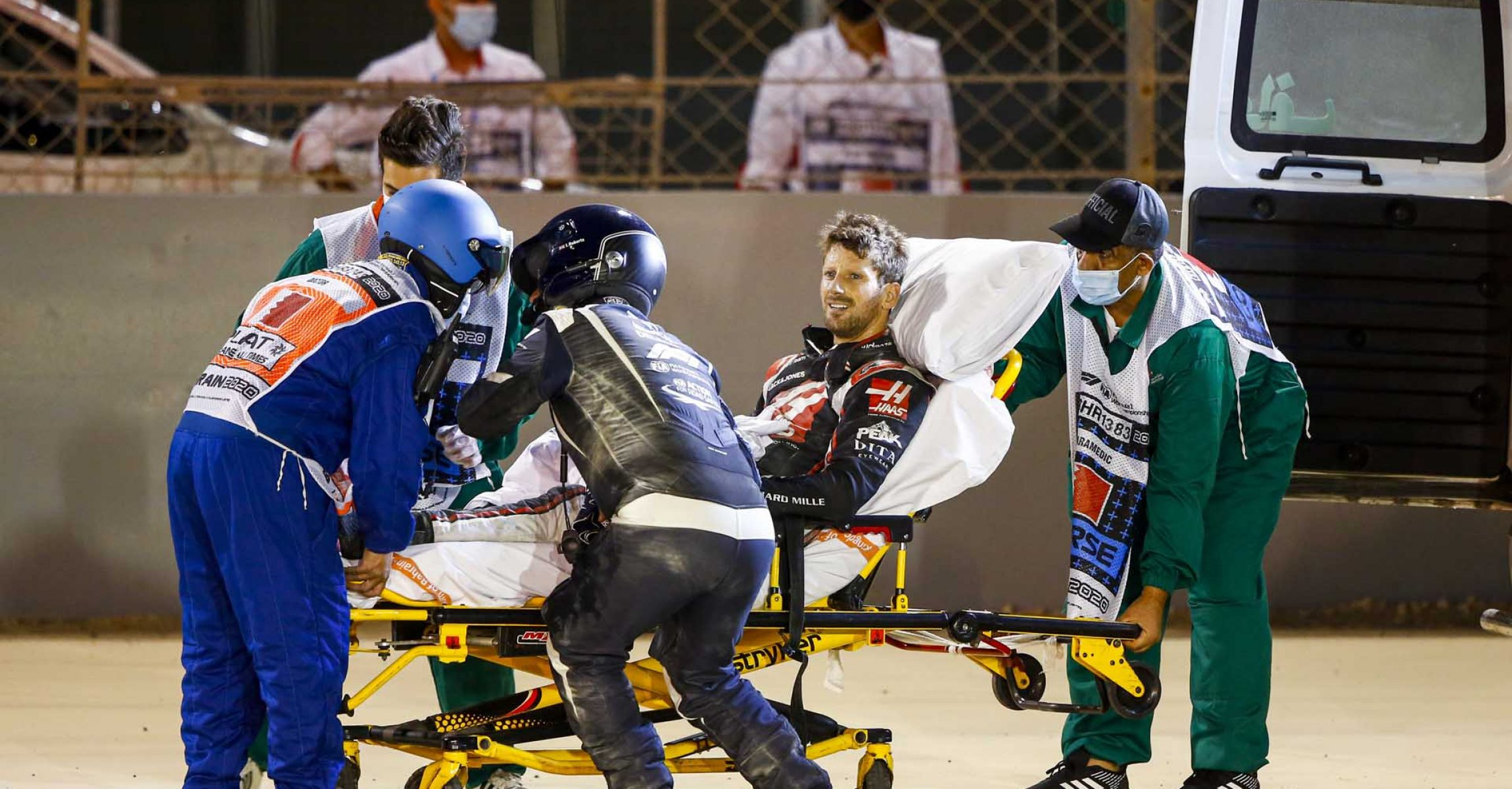 BAHRAIN INTERNATIONAL CIRCUIT, BAHRAIN - NOVEMBER 29: Romain Grosjean, Haas F1, is taken away on a stretcher after his opening lap crash during the Bahrain GP at Bahrain International Circuit on Sunday November 29, 2020 in Sakhir, Bahrain. (Photo by Andy Hone / LAT Images)
