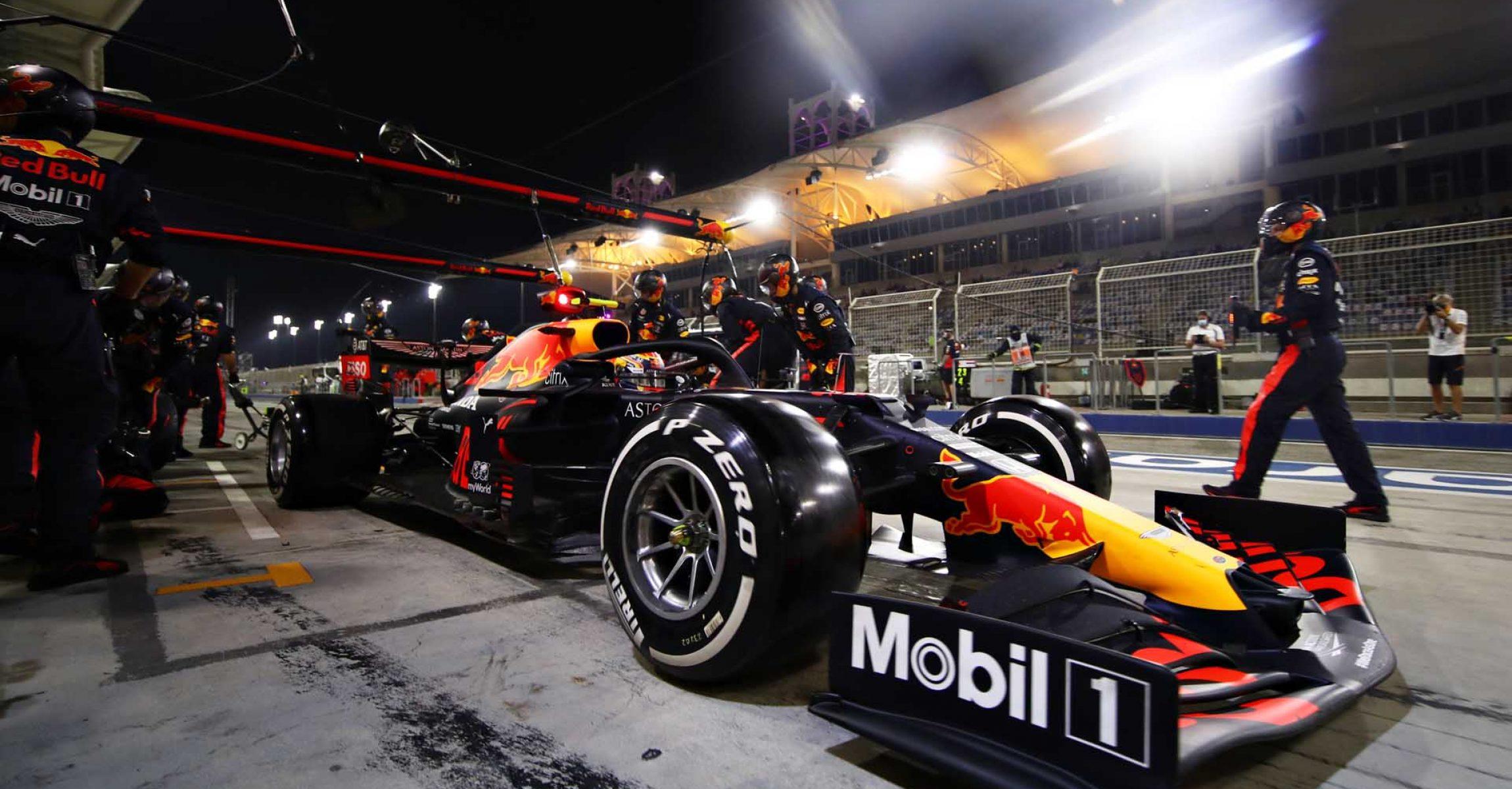 BAHRAIN, BAHRAIN - NOVEMBER 29: Alexander Albon of Thailand driving the (23) Aston Martin Red Bull Racing RB16 makes a pitstop during the F1 Grand Prix of Bahrain at Bahrain International Circuit on November 29, 2020 in Bahrain, Bahrain. (Photo by Mark Thompson/Getty Images)