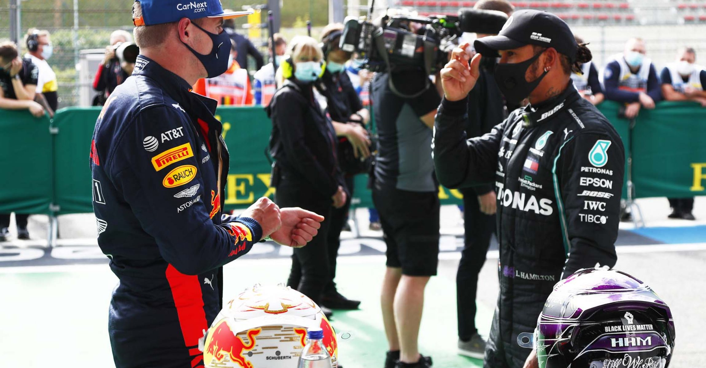 SPA, BELGIUM - AUGUST 29: Pole position qualifier Lewis Hamilton of Great Britain and Mercedes GP and third place qualifier Max Verstappen of Netherlands and Red Bull Racing talk in parc ferme during qualifying for the F1 Grand Prix of Belgium at Circuit de Spa-Francorchamps on August 29, 2020 in Spa, Belgium. (Photo by Francois Lenoir/Pool via Getty Images)