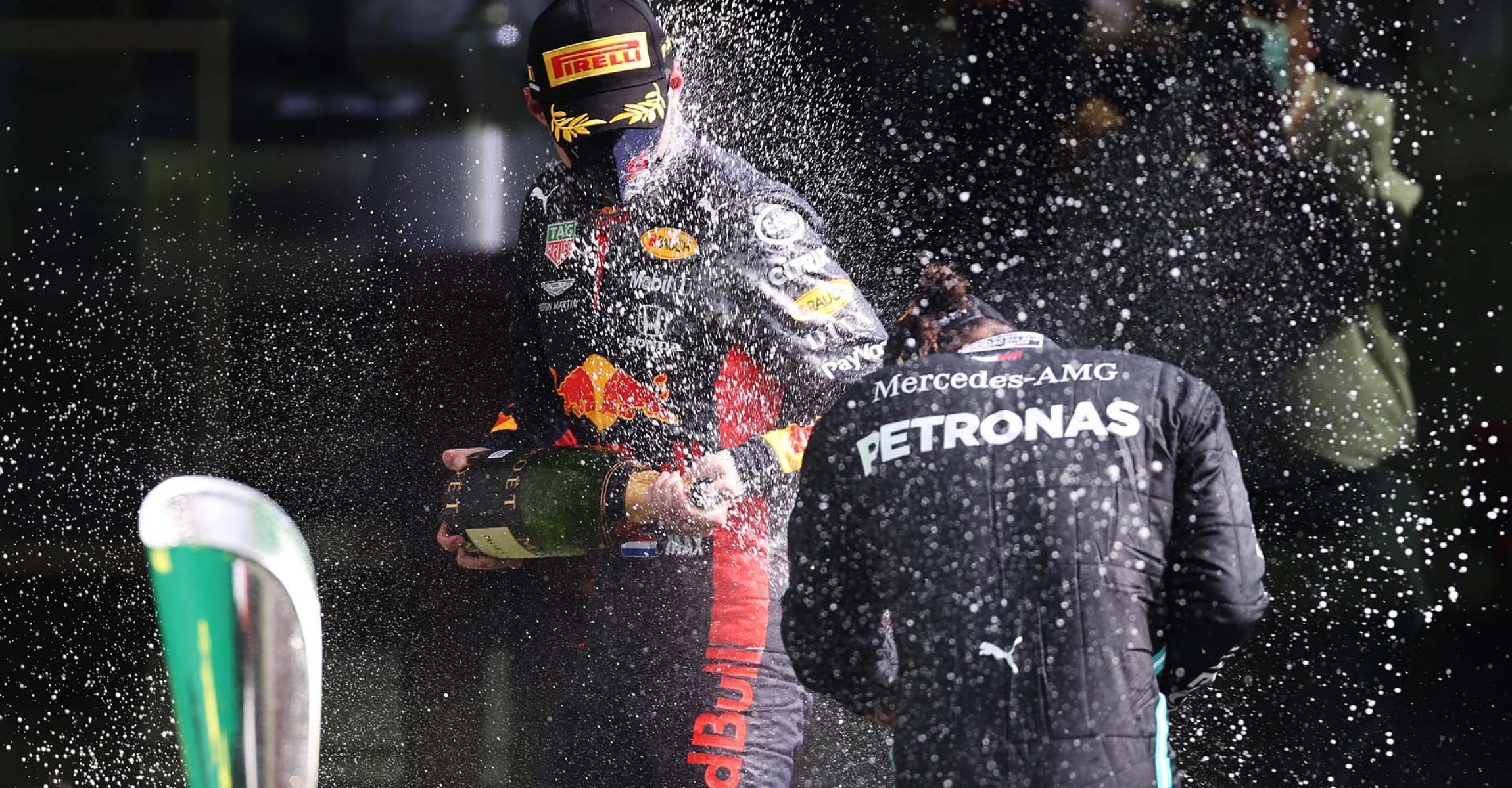 SPA, BELGIUM - AUGUST 30: Race winner Lewis Hamilton of Great Britain and Mercedes GP and Third placed Max Verstappen of Netherlands and Red Bull Racing celebrate on the podium during the F1 Grand Prix of Belgium at Circuit de Spa-Francorchamps on August 30, 2020 in Spa, Belgium. (Photo by Lars Baron/Getty Images)