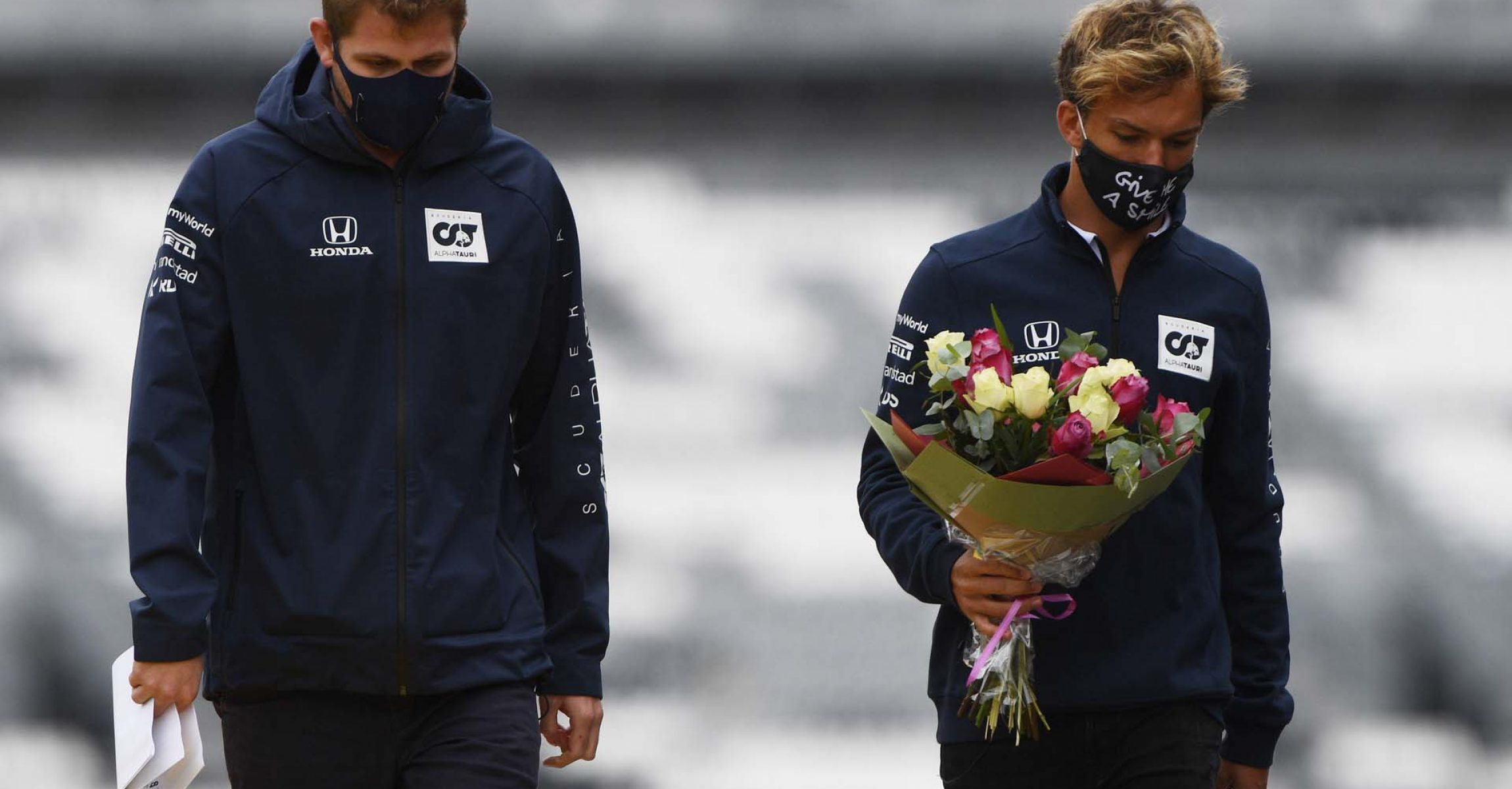 SPA, BELGIUM - AUGUST 27: Pierre Gasly of France and Scuderia AlphaTauri carries flowers to leave at the side of the track in tribute to the late Formula 2 driver Anthoine Hubert, who passed at this race in 2019 during previews ahead of the F1 Grand Prix of Belgium at Circuit de Spa-Francorchamps on August 27, 2020 in Spa, Belgium. (Photo by Rudy Carezzevoli/Getty Images) // Getty Images / Red Bull Content Pool  // SI202008270295 // Usage for editorial use only //
