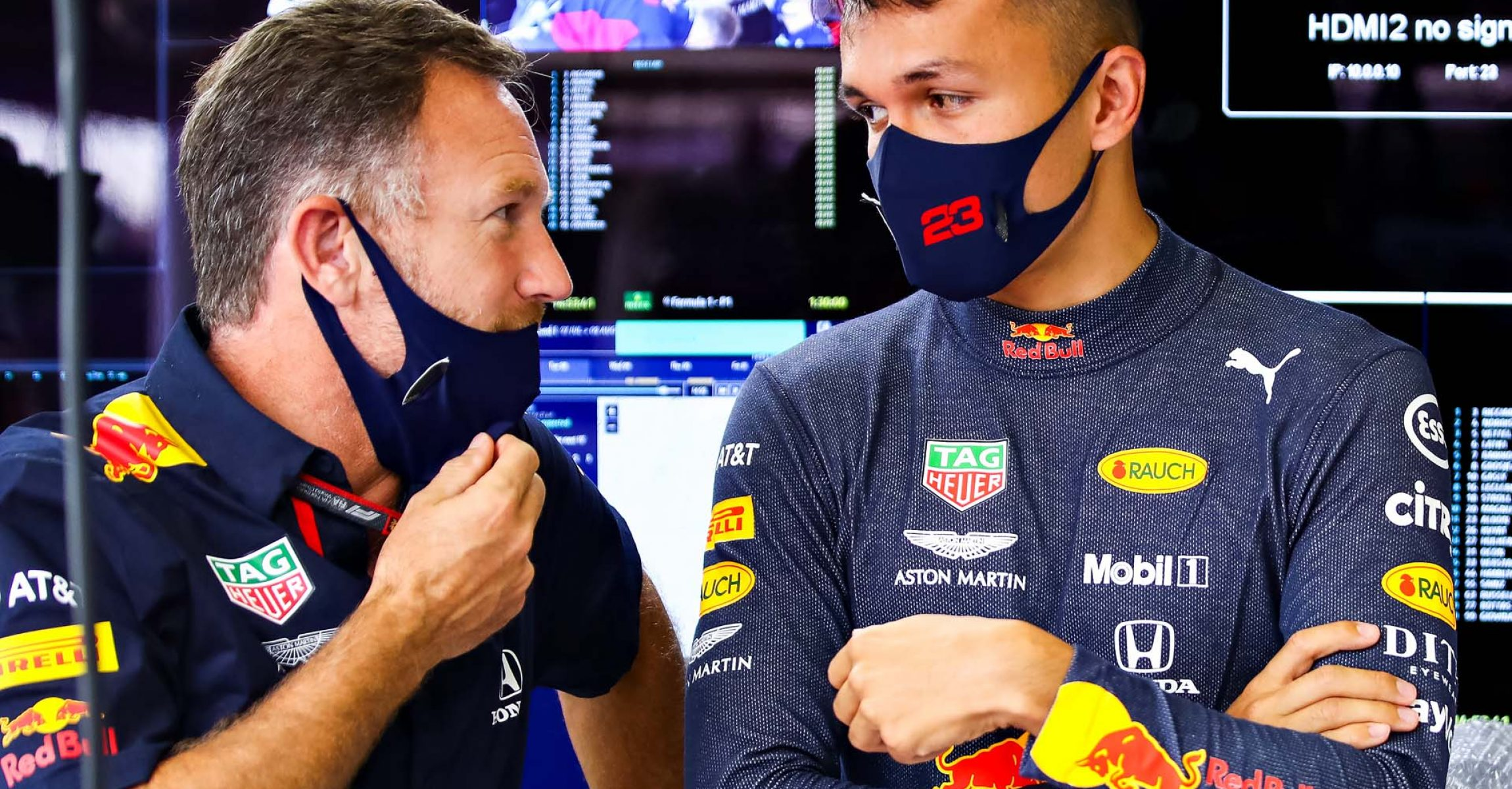 NORTHAMPTON, ENGLAND - JULY 31: Alexander Albon of Thailand and Red Bull Racing and Red Bull Racing Team Principal Christian Horner talk in the garage during practice for the F1 Grand Prix of Great Britain at Silverstone on July 31, 2020 in Northampton, England. (Photo by Mark Thompson/Getty Images,)