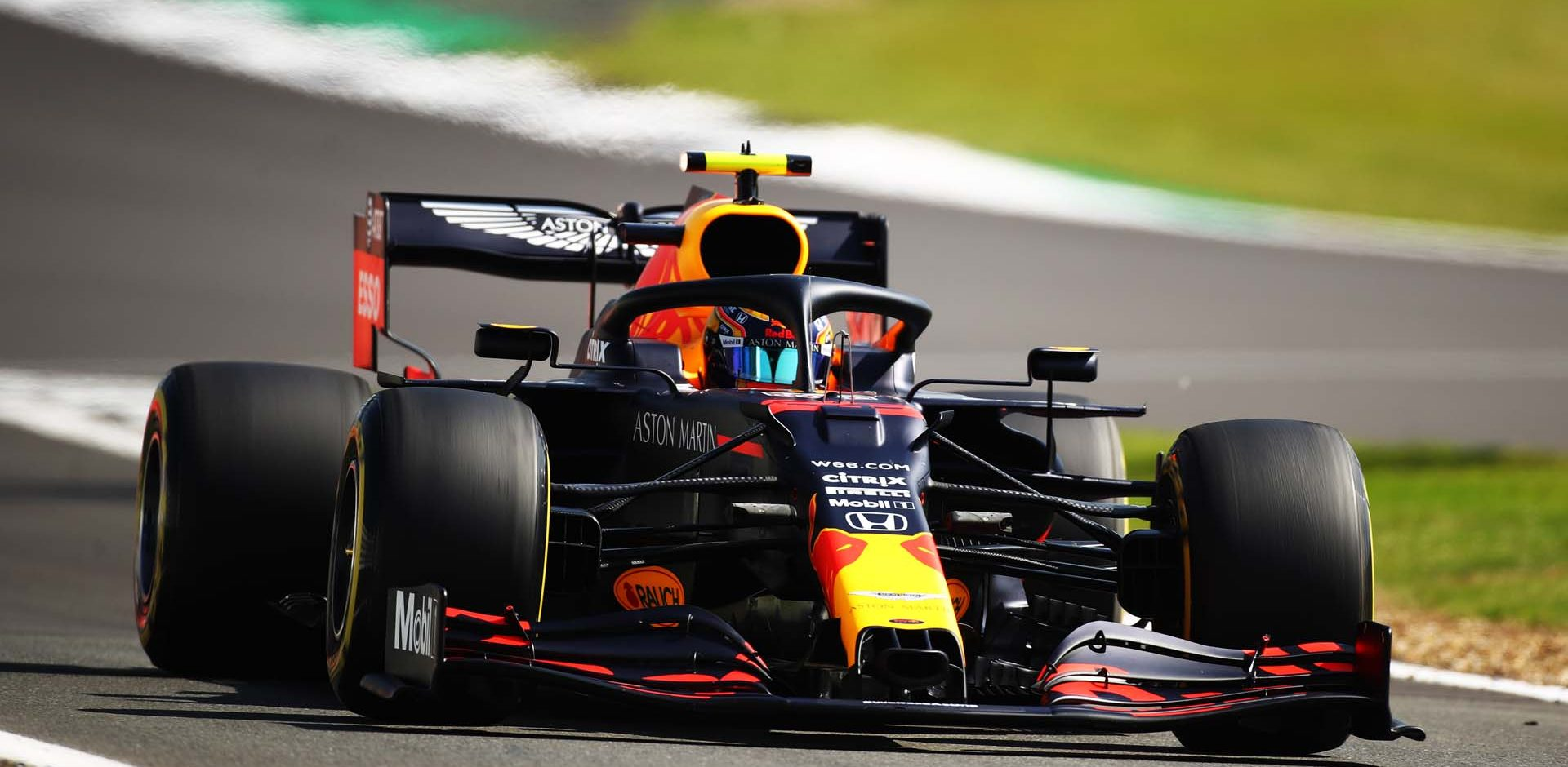 NORTHAMPTON, ENGLAND - JULY 31: Alexander Albon of Thailand driving the (23) Aston Martin Red Bull Racing RB16 on track during practice for the F1 Grand Prix of Great Britain at Silverstone on July 31, 2020 in Northampton, England. (Photo by Bryn Lennon/Getty Images)