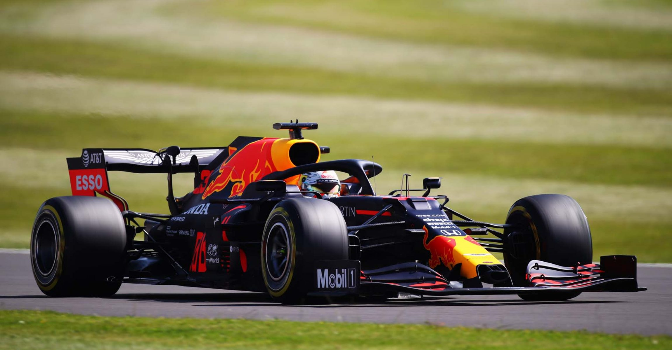 NORTHAMPTON, ENGLAND - JULY 31: Max Verstappen of the Netherlands driving the (33) Aston Martin Red Bull Racing RB16 on track during practice for the F1 Grand Prix of Great Britain at Silverstone on July 31, 2020 in Northampton, England. (Photo by Bryn Lennon/Getty Images)