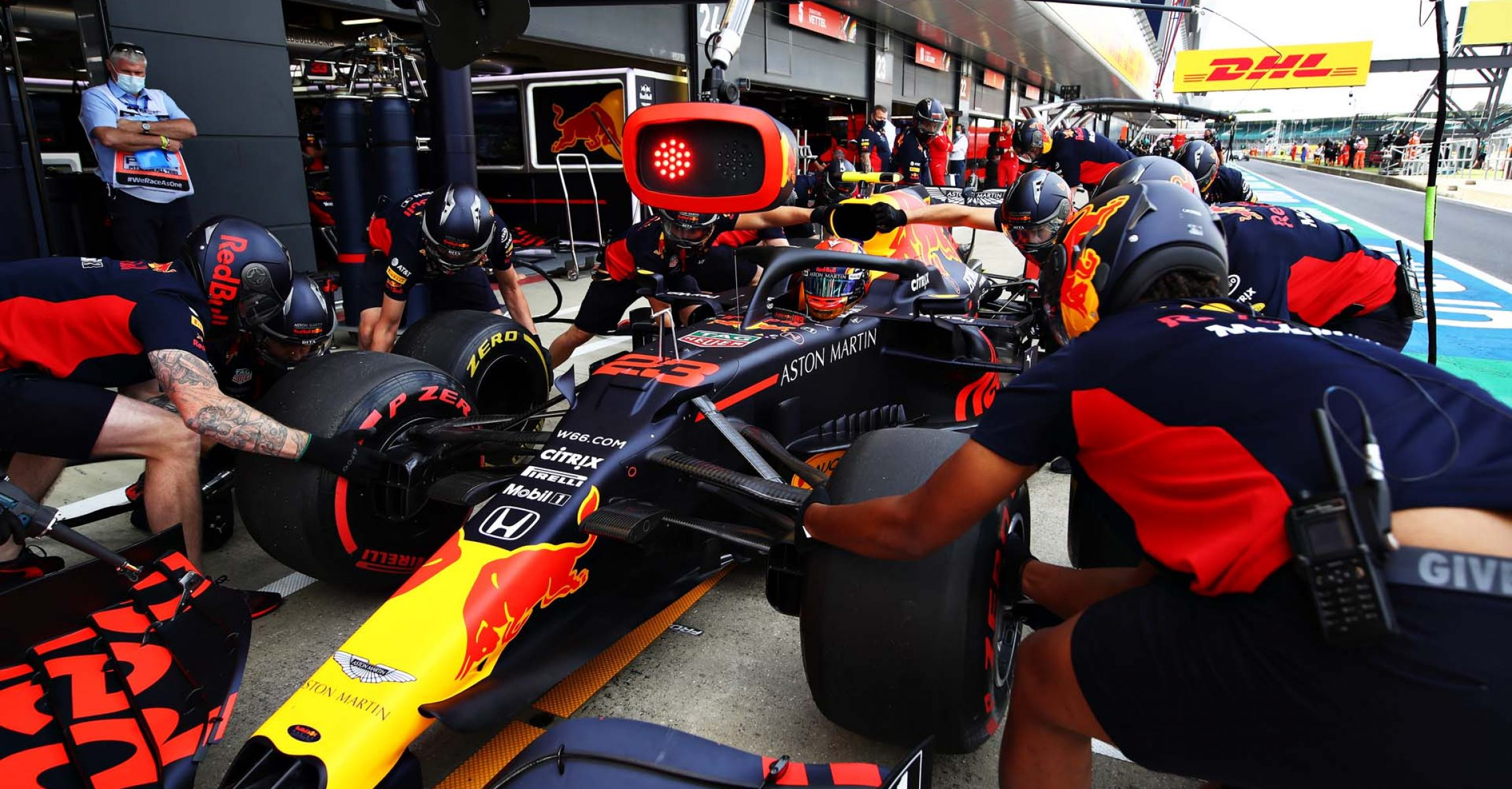 NORTHAMPTON, ENGLAND - AUGUST 01: Alexander Albon of Thailand driving the (23) Aston Martin Red Bull Racing RB16 stops in the Pitlane during final practice for the F1 Grand Prix of Great Britain at Silverstone on August 01, 2020 in Northampton, England. (Photo by Mark Thompson/Getty Images)
