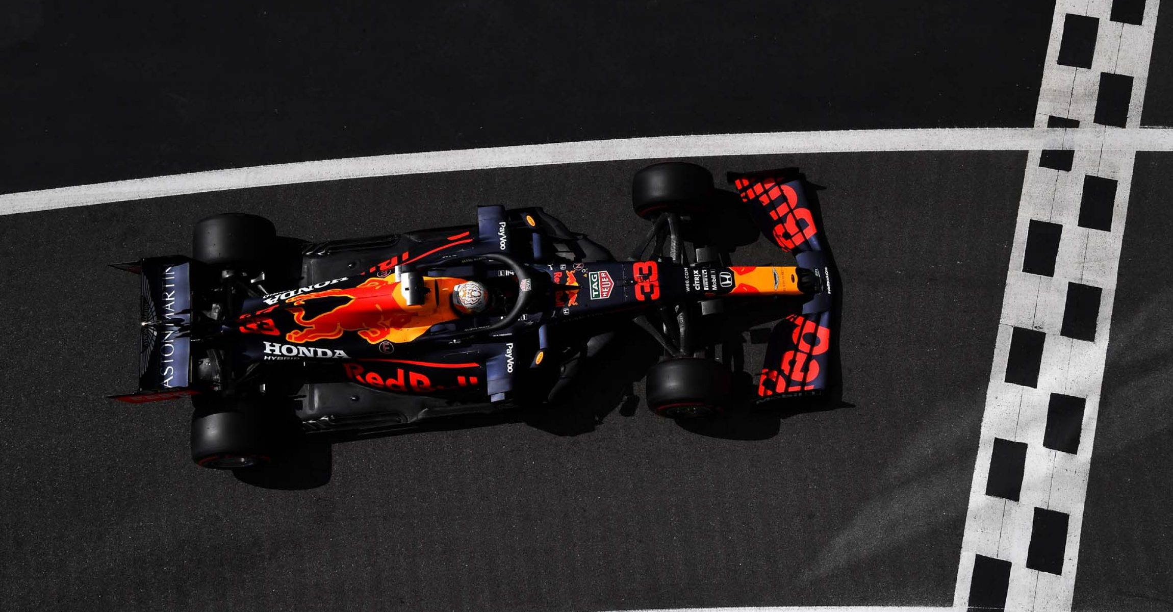 NORTHAMPTON, ENGLAND - AUGUST 01: Max Verstappen of the Netherlands driving the (33) Aston Martin Red Bull Racing RB16 comes into the pit lane during qualifying for the F1 Grand Prix of Great Britain at Silverstone on August 01, 2020 in Northampton, England. (Photo by Ben Stansall/Pool via Getty Images)
