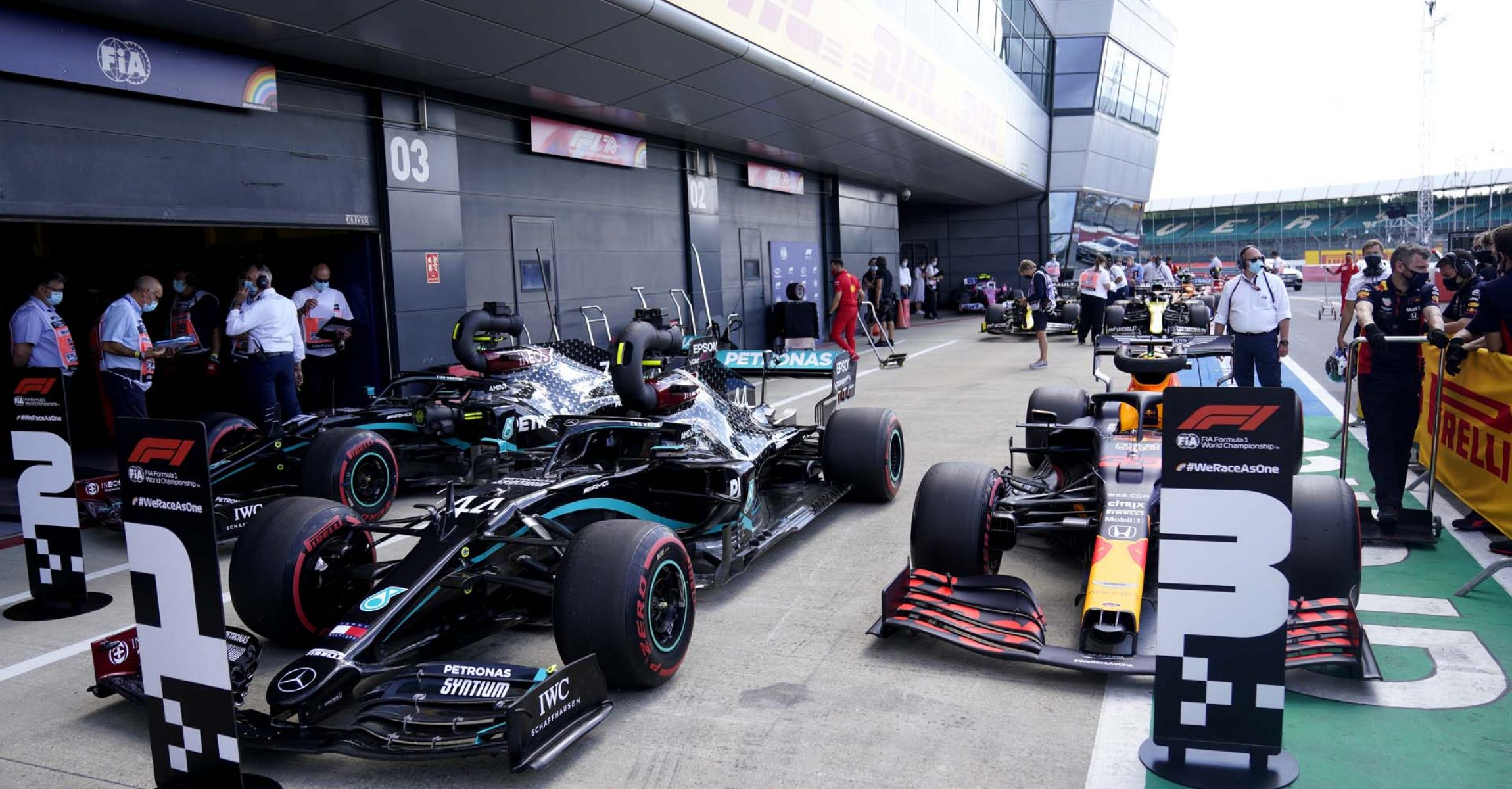 NORTHAMPTON, ENGLAND - AUGUST 01: The cars of Lewis Hamilton of Great Britain and Mercedes GP, Max Verstappen of Netherlands and Red Bull Racing and Valtteri Bottas of Finland and Mercedes GP in parc ferme after qualifying for the F1 Grand Prix of Great Britain at Silverstone on August 01, 2020 in Northampton, England. (Photo by Will Oliver/Pool via Getty Images)