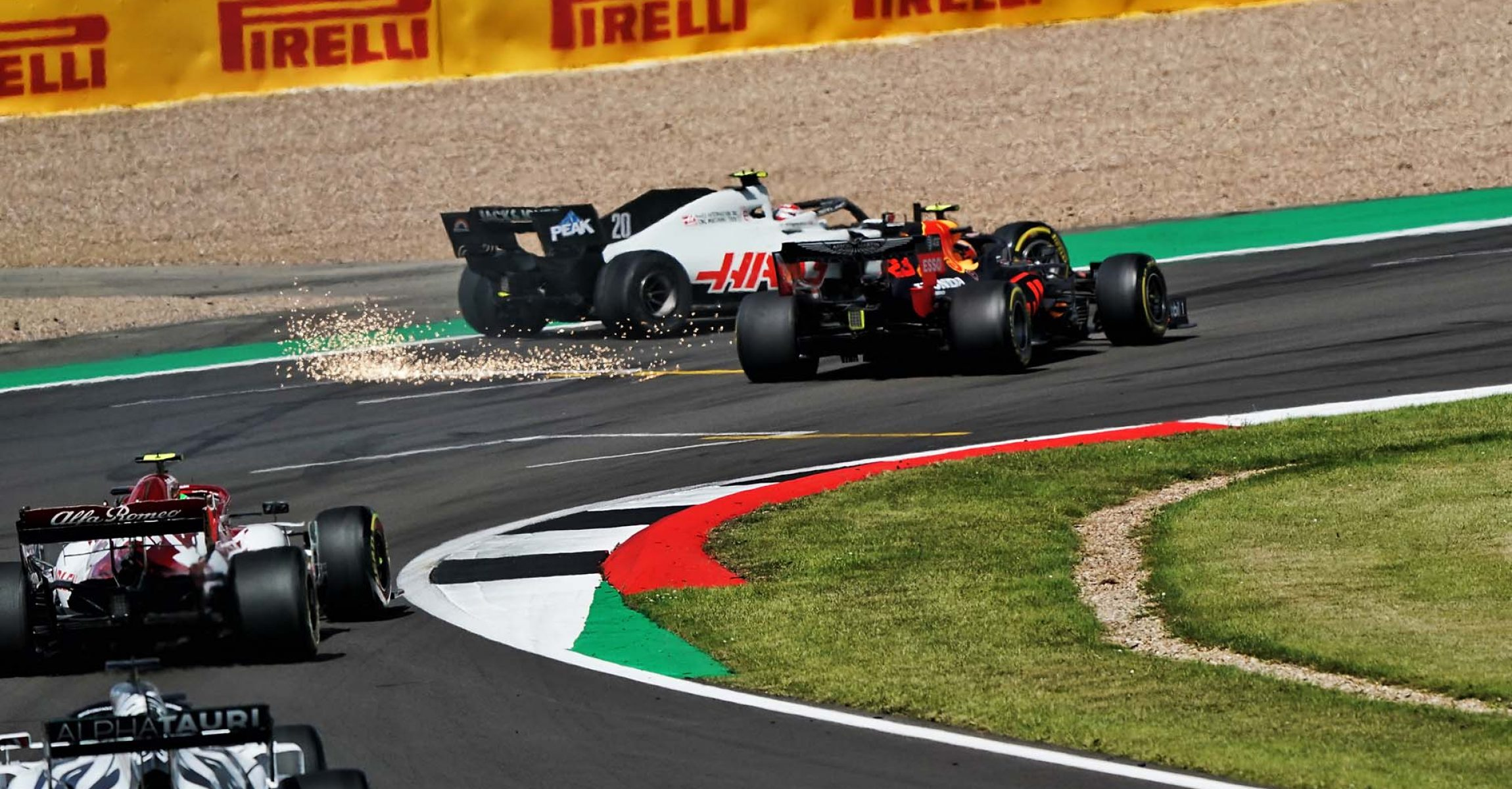 Kevin Magnussen (DEN) Haas VF-20 and Alexander Albon (THA) Red Bull Racing RB16 collide.                                02.08.2020. Formula 1 World Championship, Rd 4, British Grand Prix, Silverstone, England, Race Day. - www.xpbimages.com, EMail: requests@xpbimages.com © Copyright: FIA Pool For Editorial Use Only