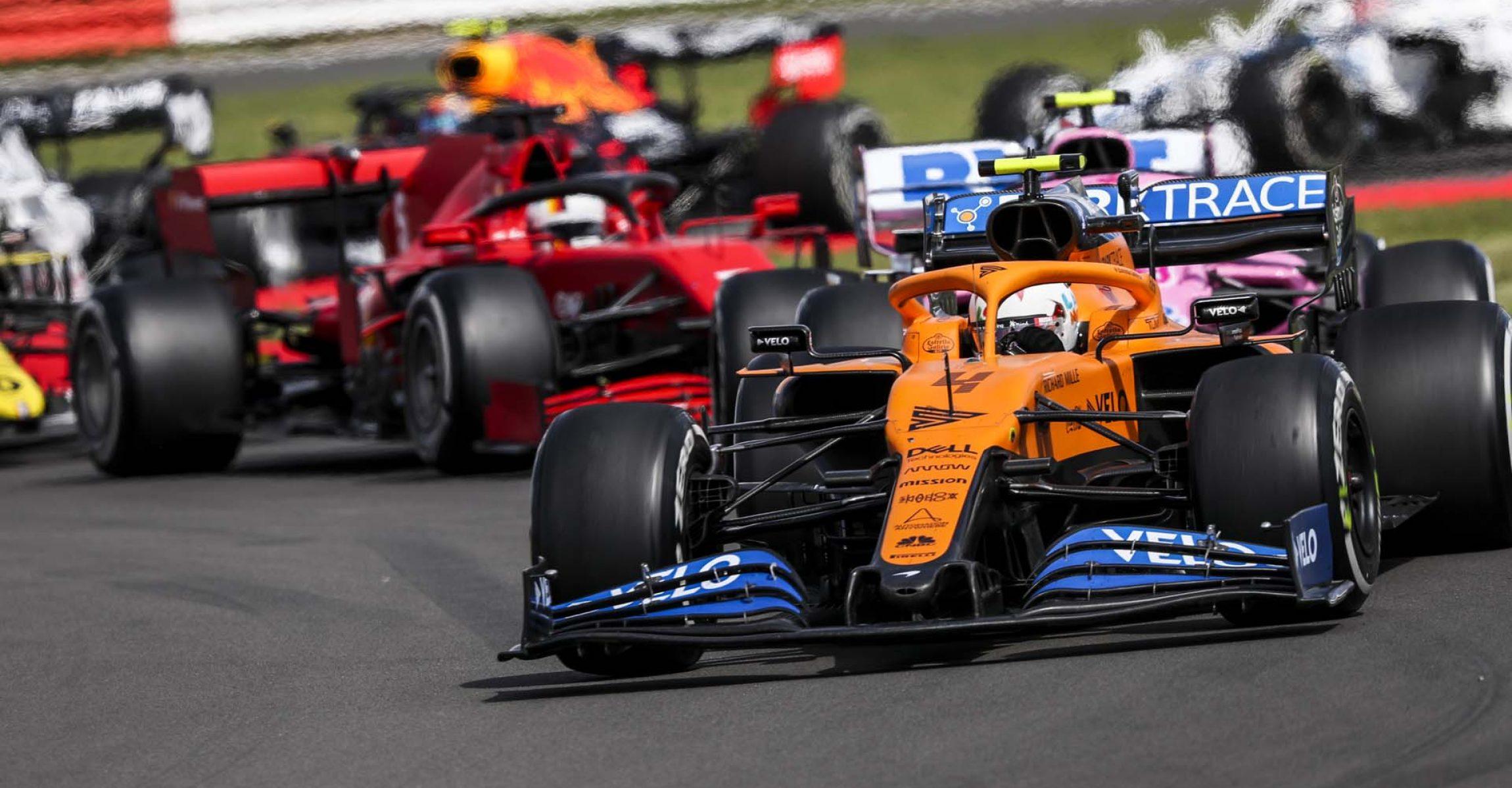 Lando Norris, McLaren MCL35, leads Lance Stroll, Racing Point RP20, Sebastian Vettel, Ferrari SF1000, and Esteban Ocon, Renault R.S.20
