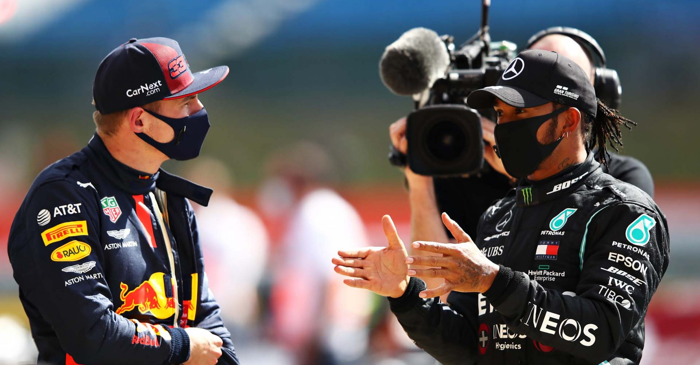 NORTHAMPTON, ENGLAND - AUGUST 02: Race winner Lewis Hamilton of Great Britain and Mercedes GP talks with second placed Max Verstappen of Netherlands and Red Bull Racing in parc ferme during the F1 Grand Prix of Great Britain at Silverstone on August 02, 2020 in Northampton, England. (Photo by Mark Thompson/Getty Images)
