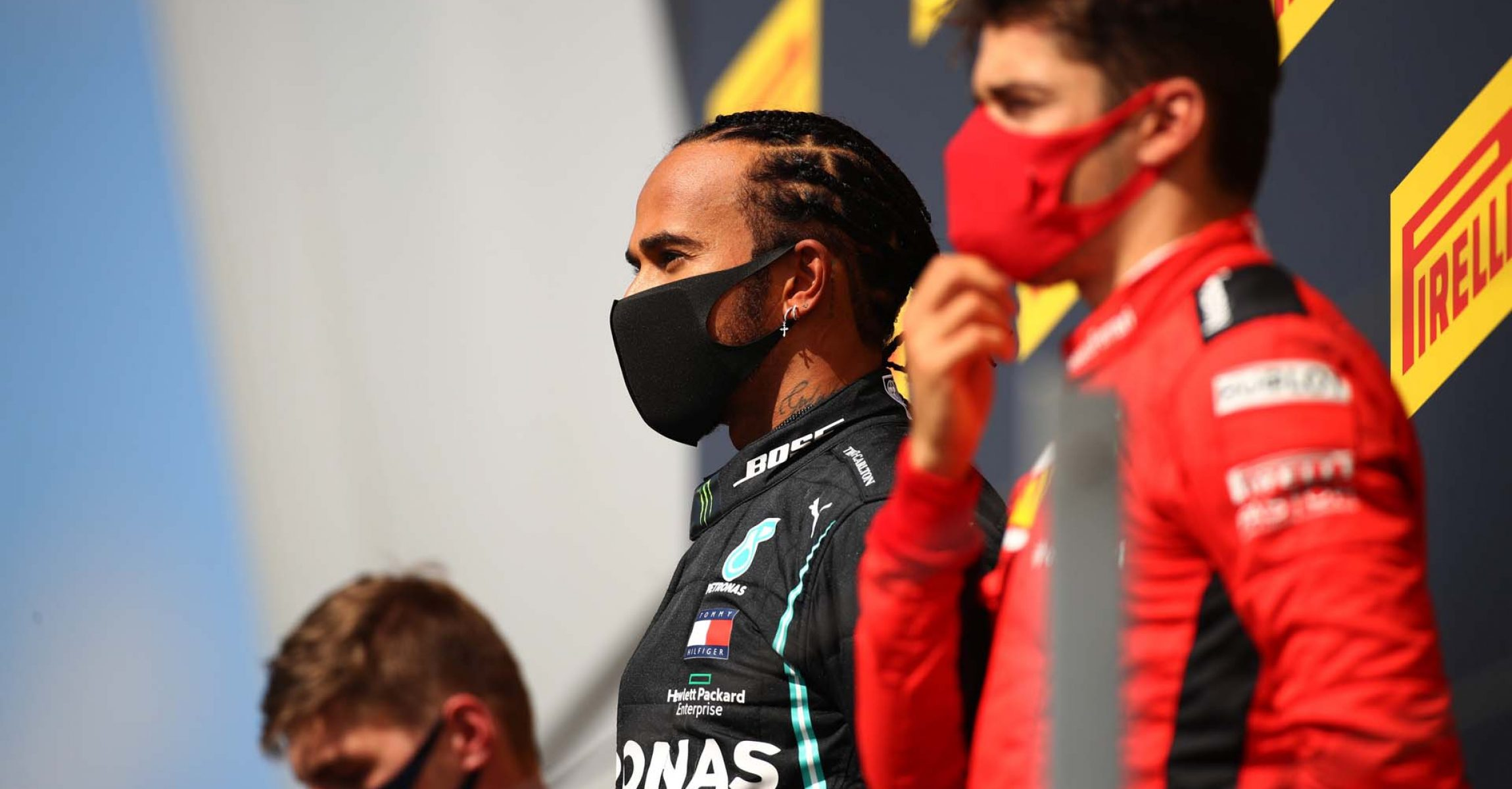 NORTHAMPTON, ENGLAND - AUGUST 02: Race winner Lewis Hamilton of Great Britain and Mercedes GP (C), runner-up Max Verstappen of Netherlands and Red Bull Racing (L) and third-placed Charles Leclerc of Monaco and Ferrari (R) stand on the podium during the F1 Grand Prix of Great Britain at Silverstone on August 02, 2020 in Northampton, England. (Photo by Bryn Lennon/Getty Images) // Getty Images / Red Bull Content Pool  // AP-24TQDPVCH2111 // Usage for editorial use only //