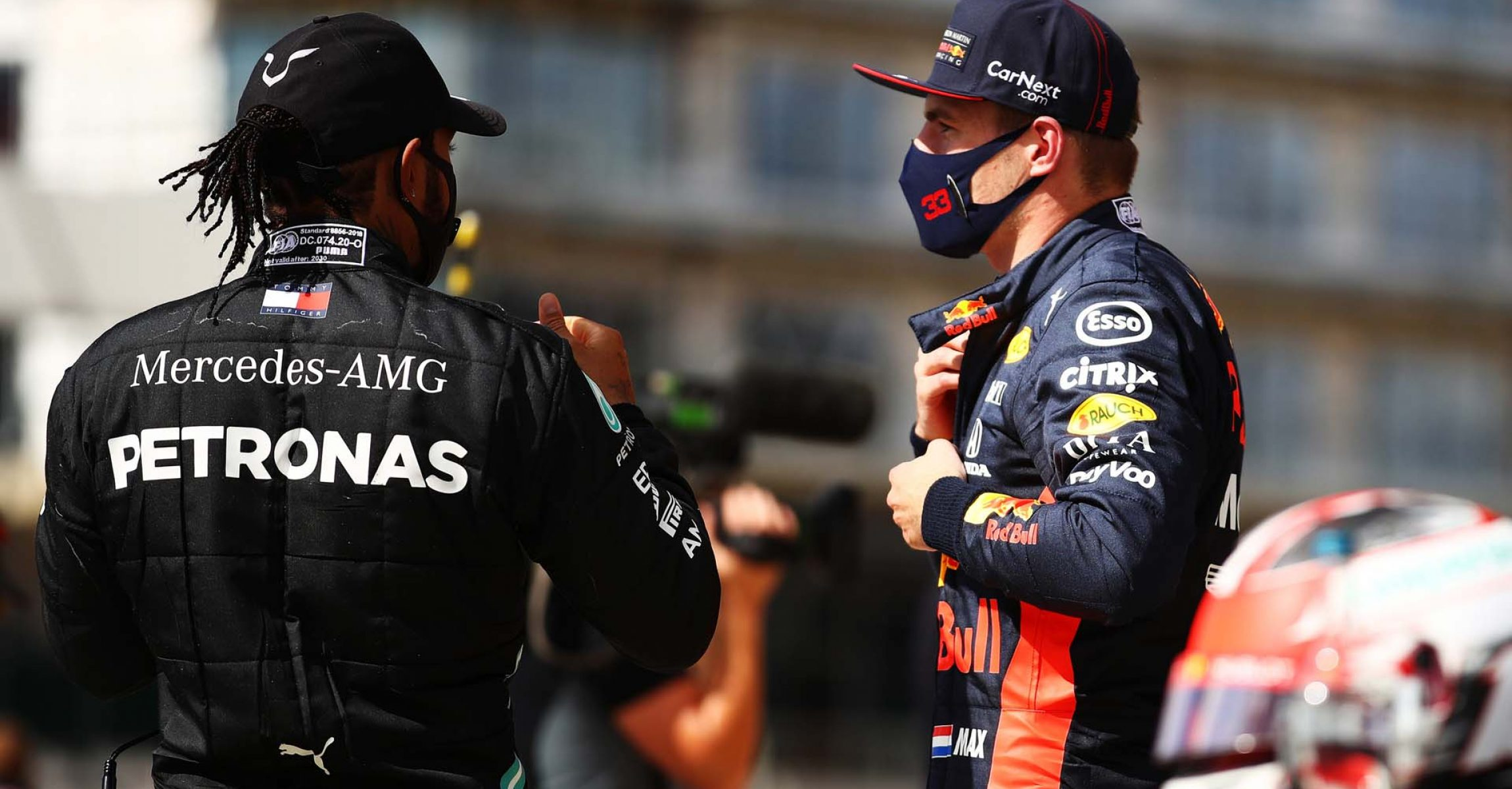 NORTHAMPTON, ENGLAND - AUGUST 02: Race winner Lewis Hamilton of Great Britain and Mercedes GP speaks with second placed Max Verstappen of Netherlands and Red Bull Racing in parc ferme during the F1 Grand Prix of Great Britain at Silverstone on August 02, 2020 in Northampton, England. (Photo by Bryn Lennon/Getty Images) // Getty Images / Red Bull Content Pool  // AP-24TQN1U852111 // Usage for editorial use only //