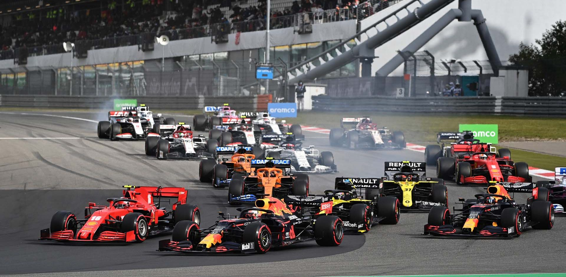 NUERBURG, GERMANY - OCTOBER 11: Max Verstappen of the Netherlands driving the (33) Aston Martin Red Bull Racing RB16 battles for position with Charles Leclerc of Monaco driving the (16) Scuderia Ferrari SF1000 at the start of the race during the F1 Eifel Grand Prix at Nuerburgring on October 11, 2020 in Nuerburg, Germany. (Photo by Ina Fassbender - Pool/Getty Images)
