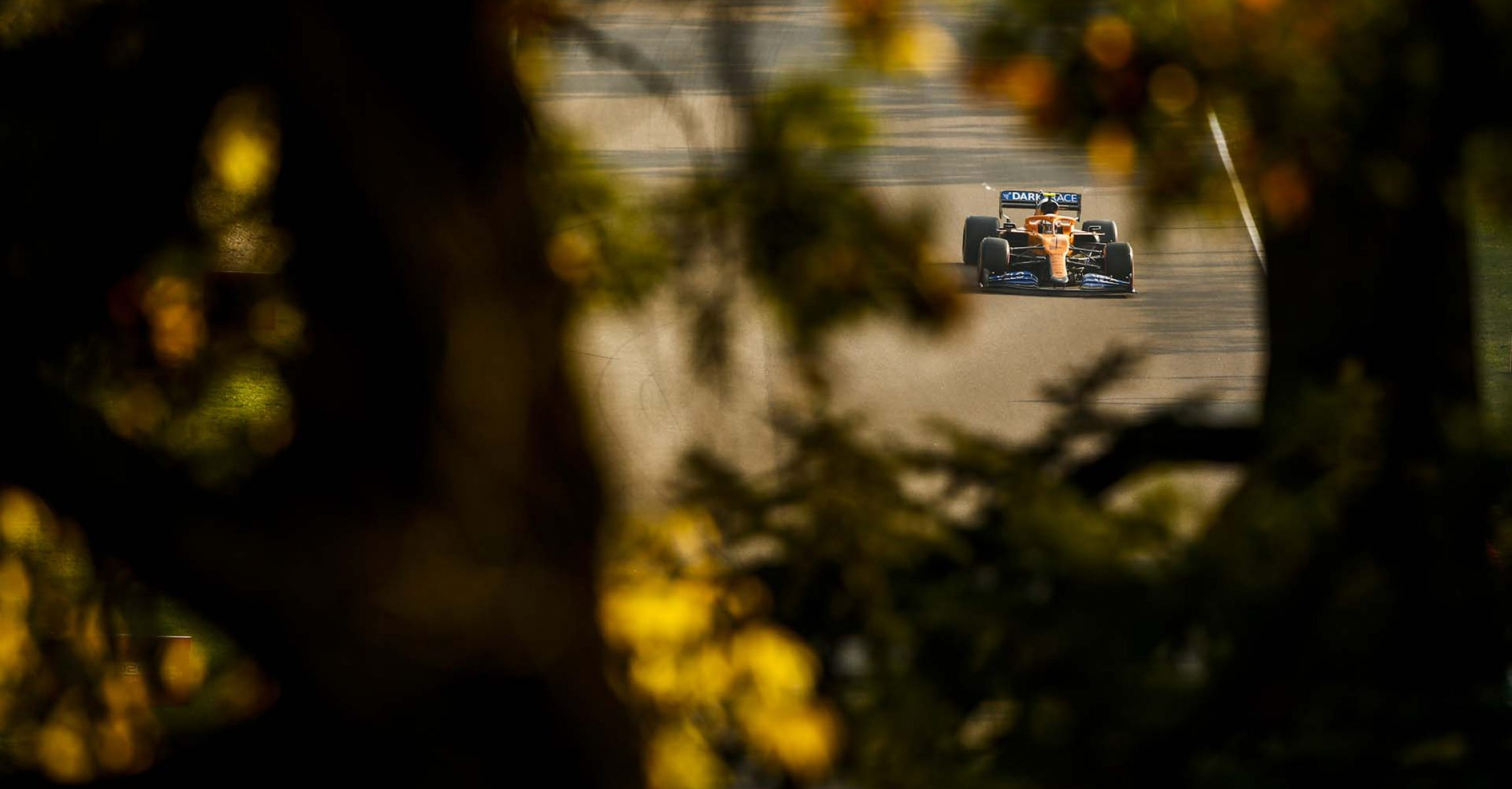 Lando Norris, McLaren MCL35, on a straight, in a scenic shot of Imola