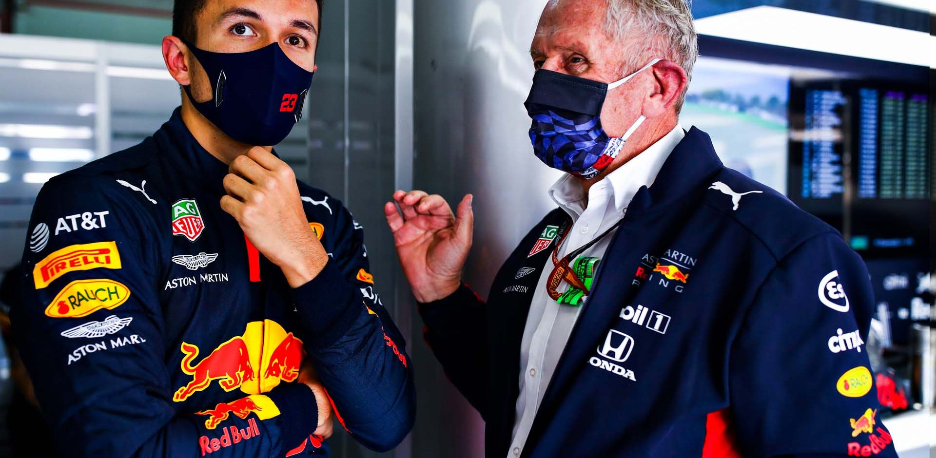 IMOLA, ITALY - OCTOBER 31: Alexander Albon of Thailand and Red Bull Racing talks with Red Bull Racing Team Consultant Dr Helmut Marko in the garage during practice ahead of the F1 Grand Prix of Emilia Romagna at Autodromo Enzo e Dino Ferrari on October 31, 2020 in Imola, Italy. (Photo by Mark Thompson/Getty Images)