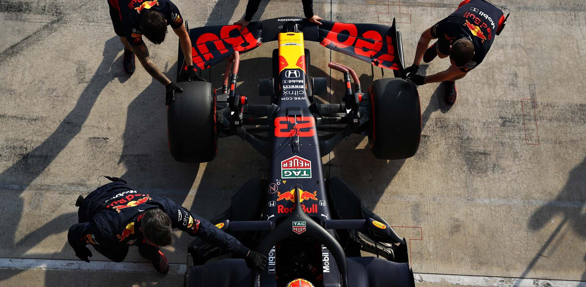 IMOLA, ITALY - OCTOBER 31: Alexander Albon of Thailand driving the (23) Aston Martin Red Bull Racing RB16 is pushed back into the garage during qualifying ahead of the F1 Grand Prix of Emilia Romagna at Autodromo Enzo e Dino Ferrari on October 31, 2020 in Imola, Italy. (Photo by Mark Thompson/Getty Images)