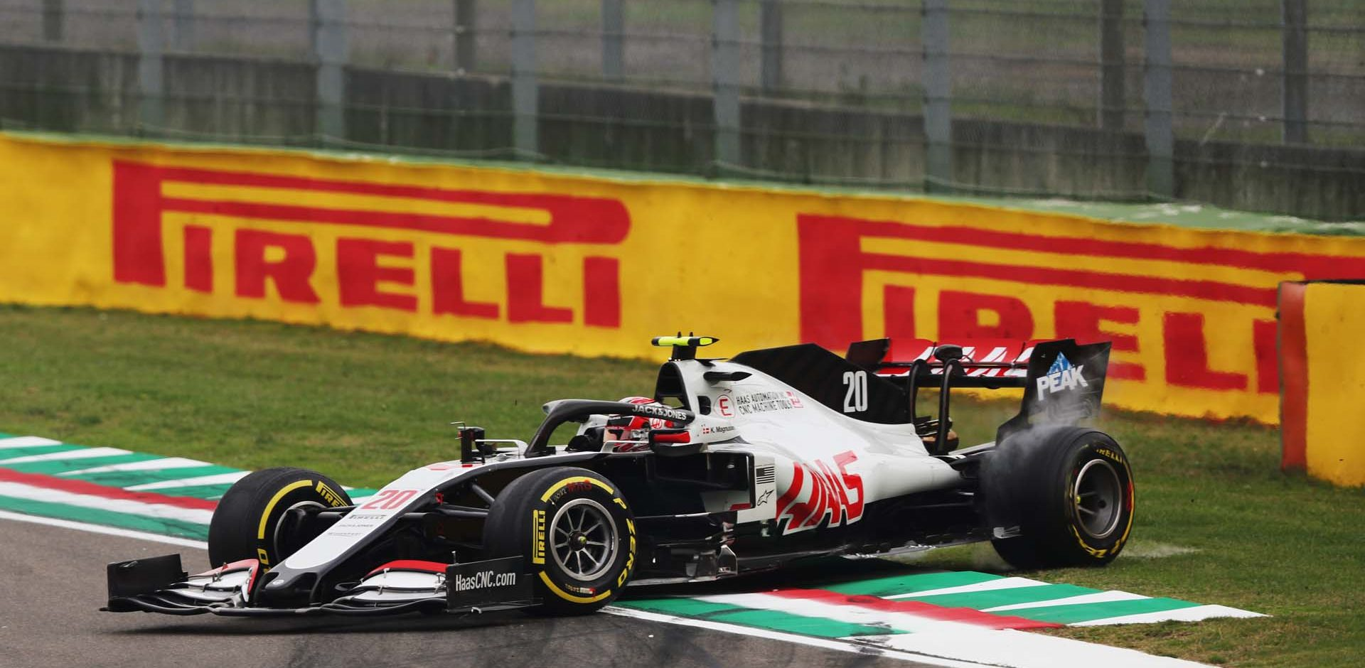 IMOLA, ITALY - NOVEMBER 01: Kevin Magnussen, Haas VF-20, spins on the way to the grid during the Emilia-Romagna GP at Imola on Sunday November 01, 2020, Italy. (Photo by Charles Coates / LAT Images)