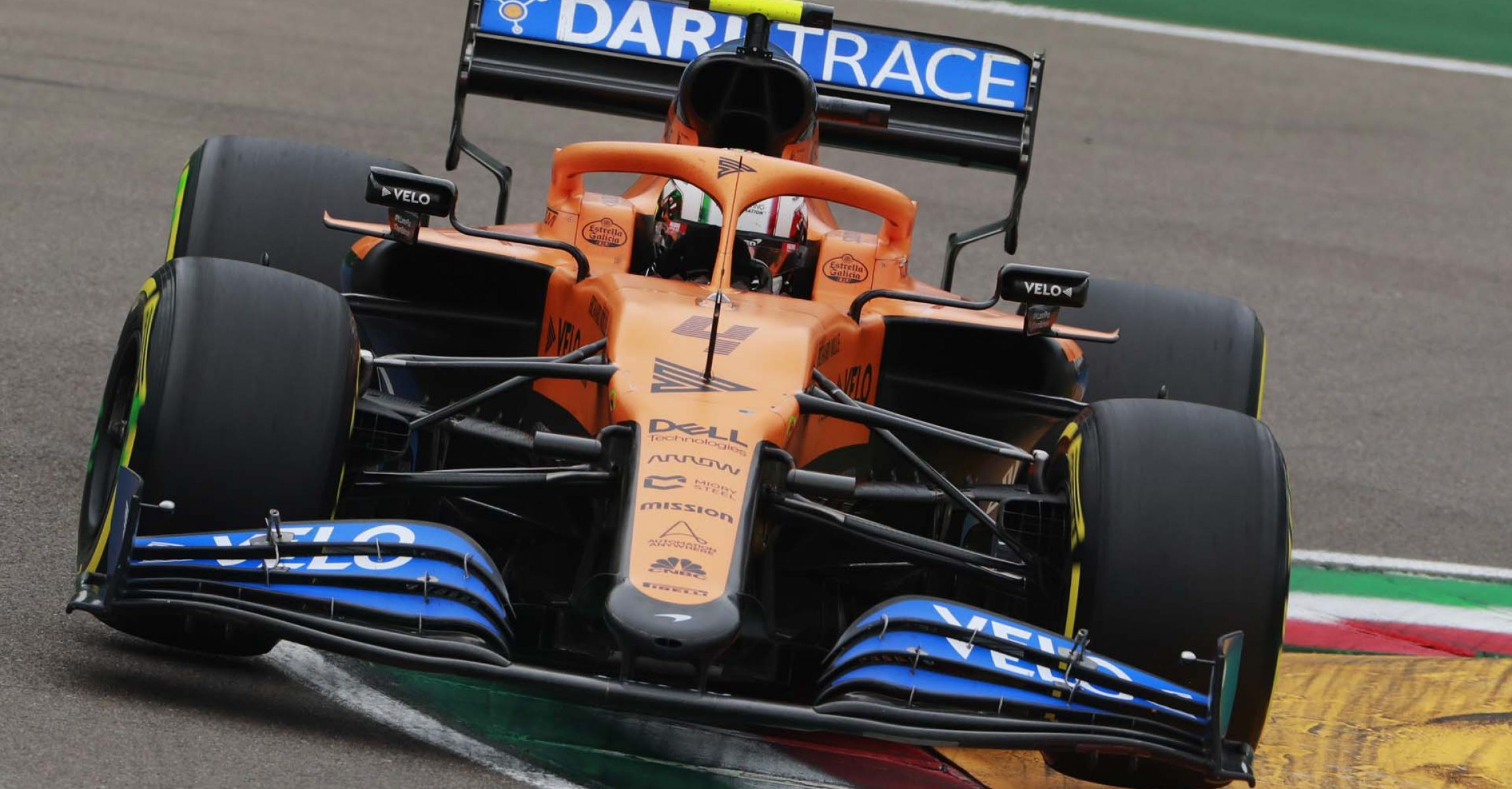 Lando Norris, McLaren MCL35, drives over a kerb in a chicane