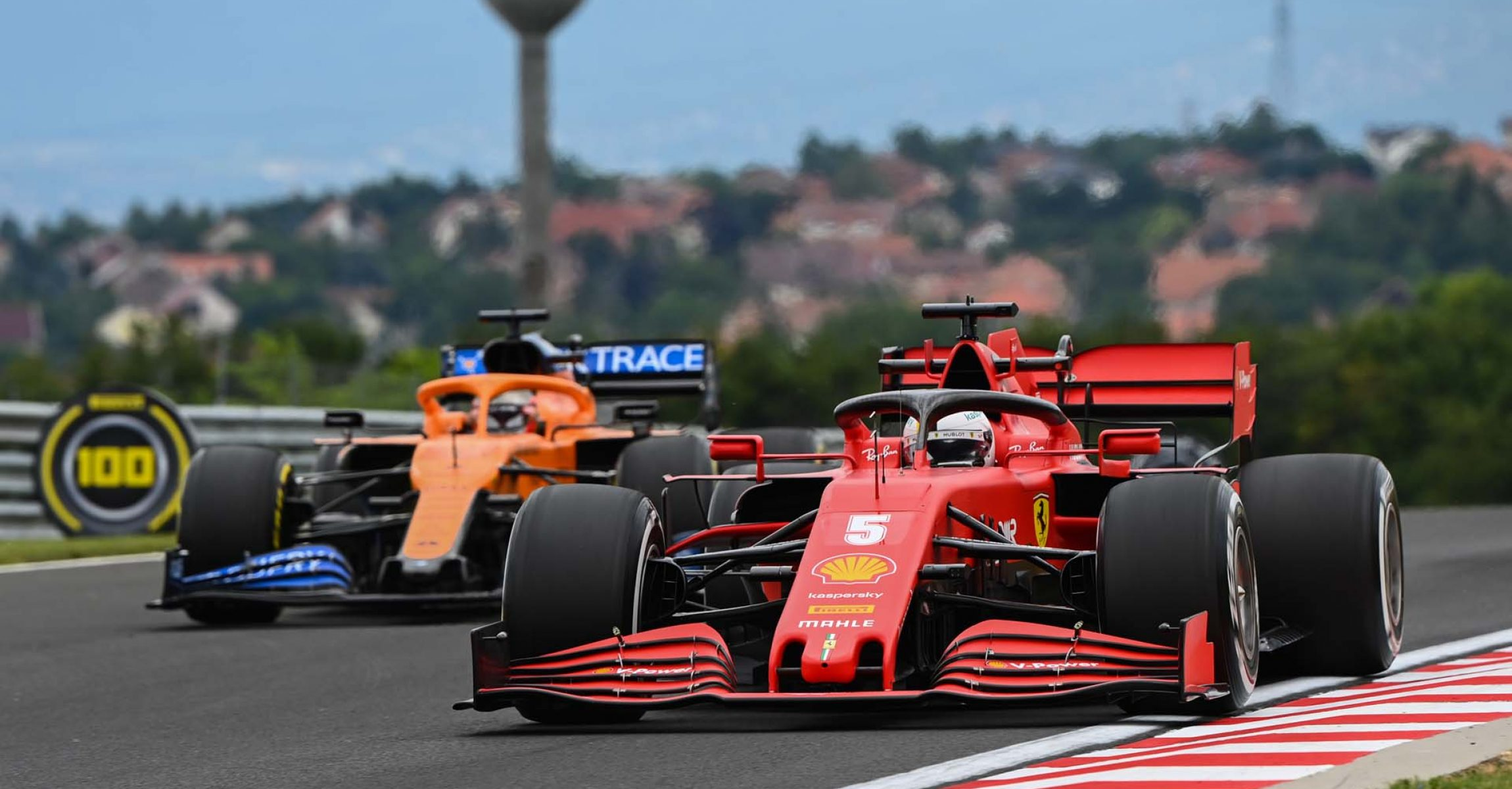 HUNGARORING, HUNGARY - JULY 17: Sebastian Vettel, Ferrari SF1000, leads Carlos Sainz, McLaren MCL35 during the Hungarian GP at Hungaroring on Friday July 17, 2020 in Budapest, Hungary. (Photo by Mark Sutton / LAT Images)