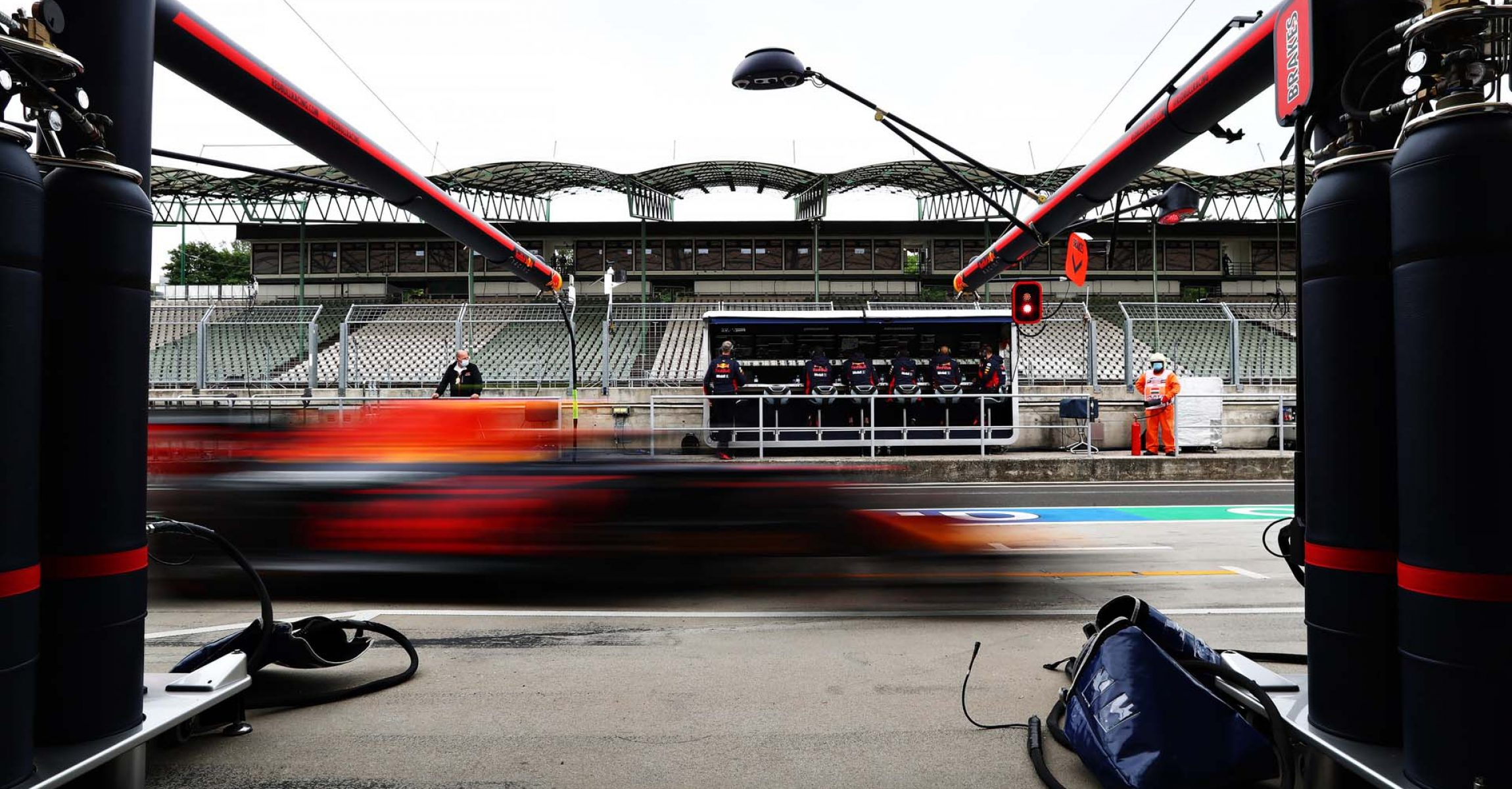 BUDAPEST, HUNGARY - JULY 18: Alexander Albon of Thailand driving the (23) Aston Martin Red Bull Racing RB16 passes his garage during qualifying for the F1 Grand Prix of Hungary at Hungaroring on July 18, 2020 in Budapest, Hungary. (Photo by Getty Images/Getty Images) // Getty Images / Red Bull Content Pool  // AP-24NVQG74W2111 // Usage for editorial use only //