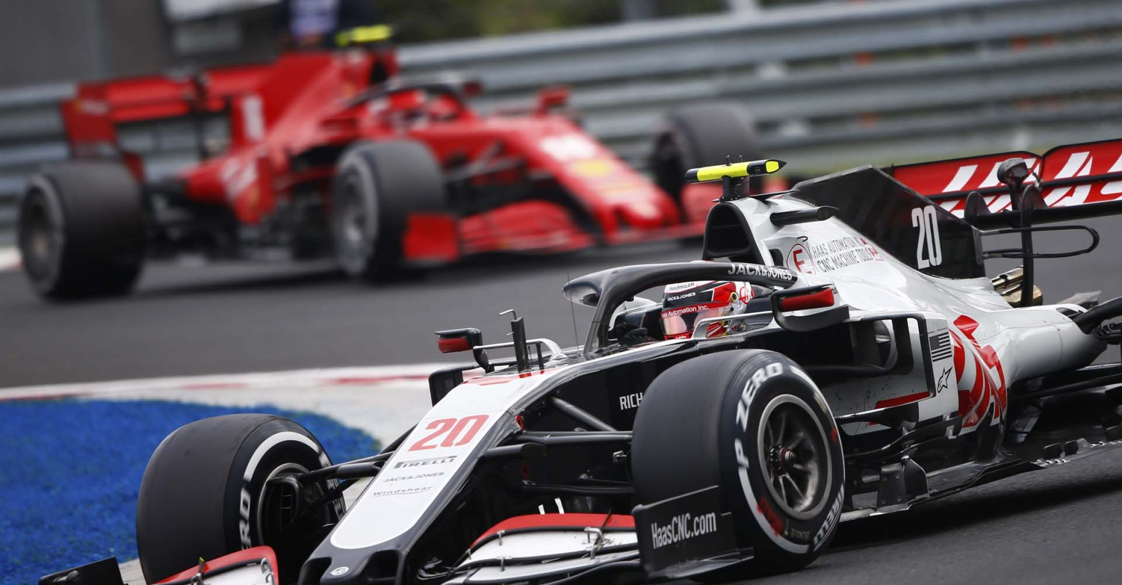 HUNGARORING, HUNGARY - JULY 19: Kevin Magnussen, Haas VF-20, leads Charles Leclerc, Ferrari SF1000 during the Hungarian GP at Hungaroring on Sunday July 19, 2020 in Budapest, Hungary. (Photo by Andy Hone / LAT Images)