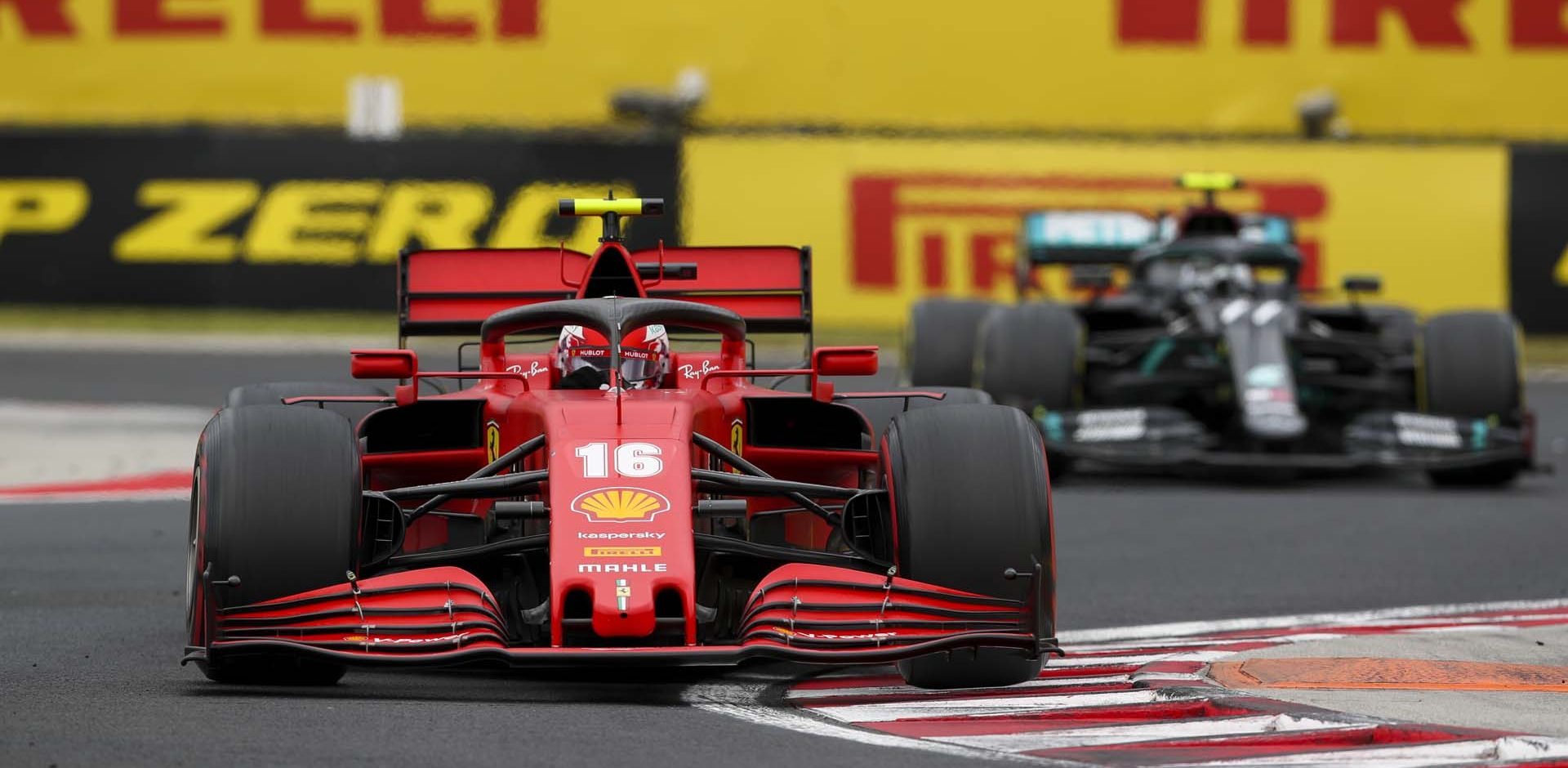 HUNGARORING, HUNGARY - JULY 19: Charles Leclerc, Ferrari SF1000, leads Valtteri Bottas, Mercedes F1 W11 EQ Performance during the Hungarian GP at Hungaroring on Sunday July 19, 2020 in Budapest, Hungary. (Photo by Charles Coates / LAT Images)